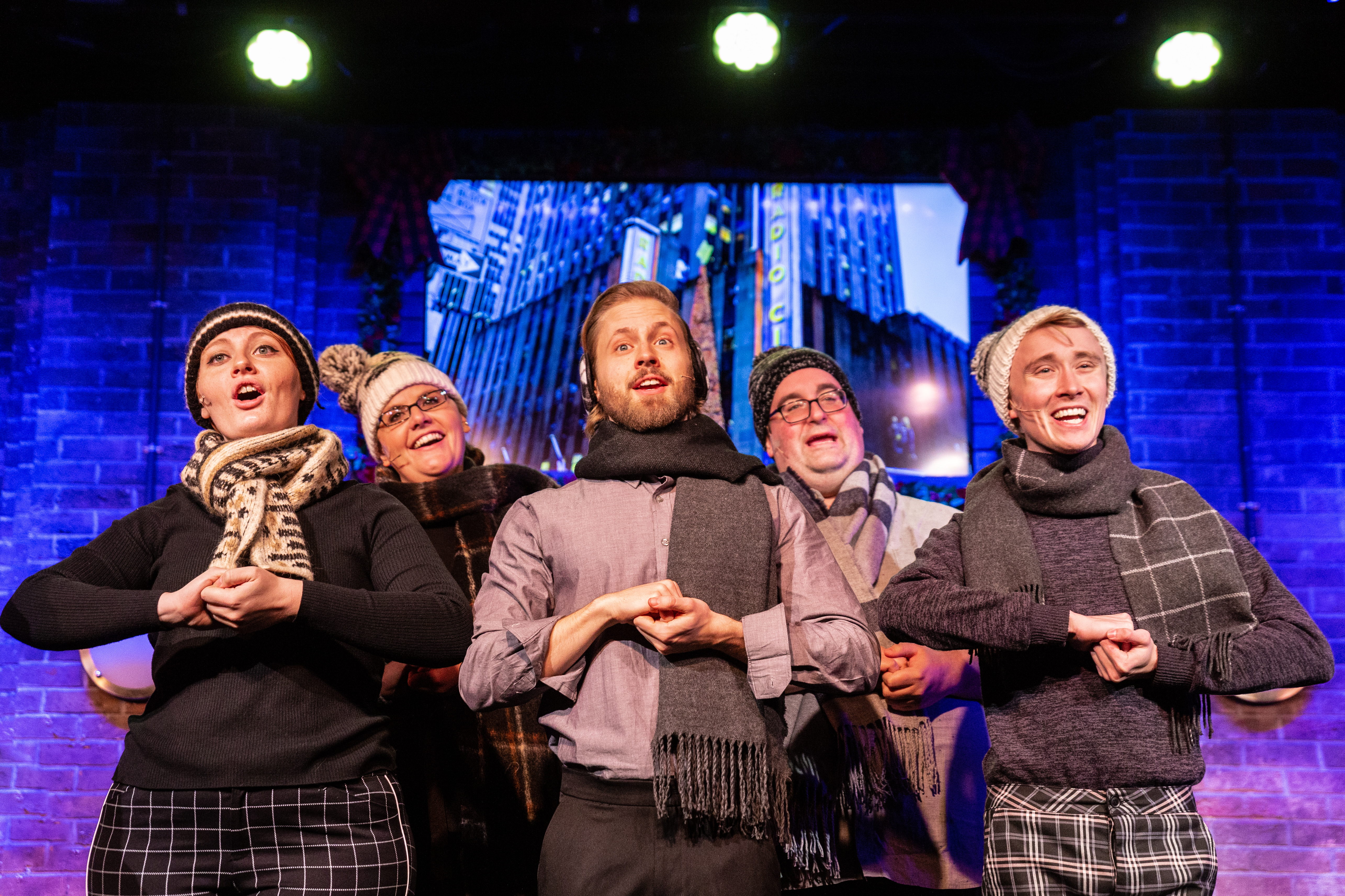 """Shelby Plummer (front row, from left), Henrik Blix, George Elrod, and (back row) Jess DeBacco and Rob Grabowski in """"Deck the Hallmark: A Greeting Card ChannelOriginal"""" at Second City."""