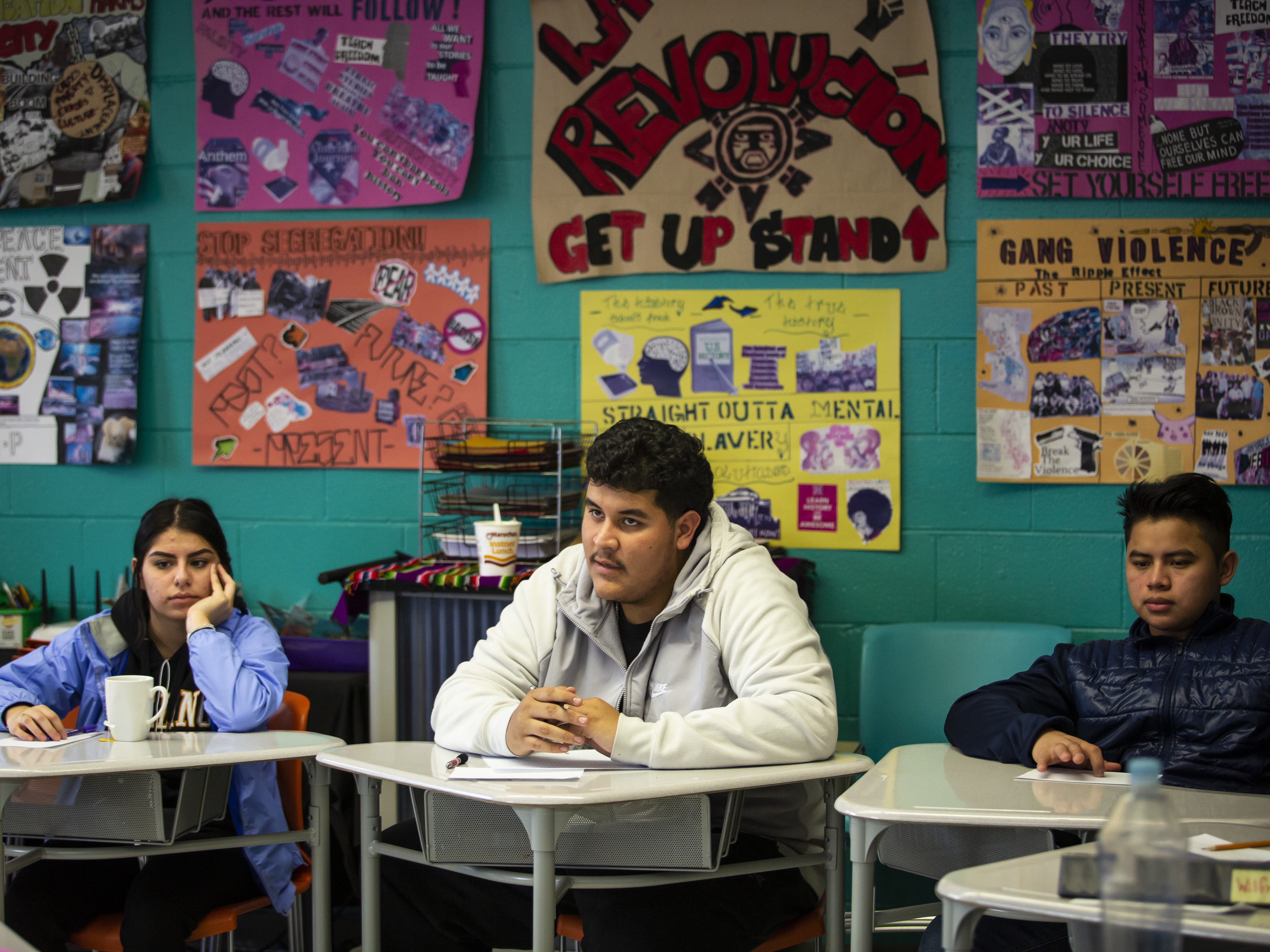 """Students Elizabeth Lopez-Jimenez, from left,  Rogelio Villegas,and Esvin Cortez, students in Instituto Justice and Leadership Academy's history class, """"Chicago: A Struggle for Equity."""""""