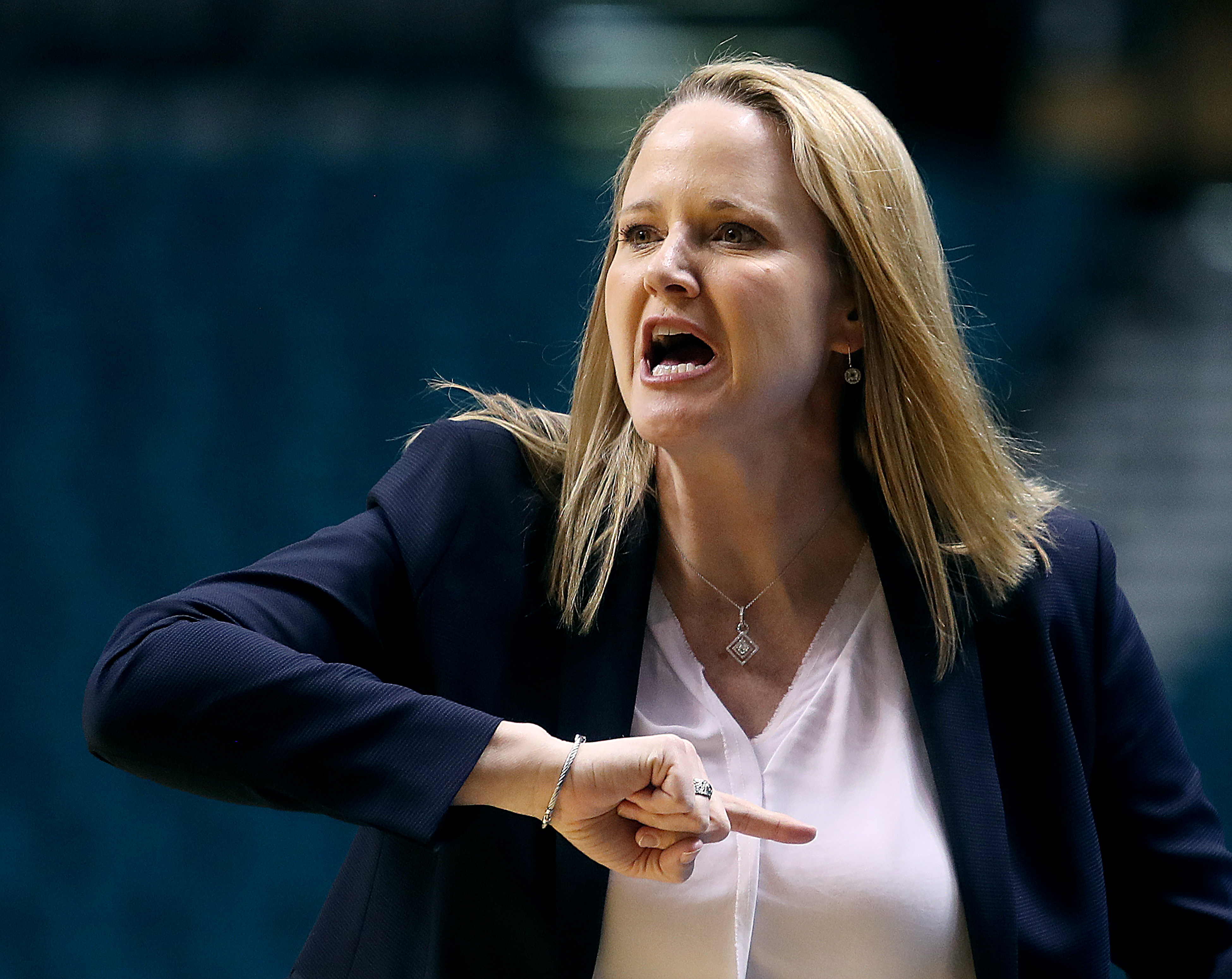Utah Utes head coach Lynne Roberts directs her team as Utah and Washington play in Pac-12 tournament action at the MGM Grand Garden Arena in Las Vegas on Thursday, March 7, 2019. Washington won 64-54.