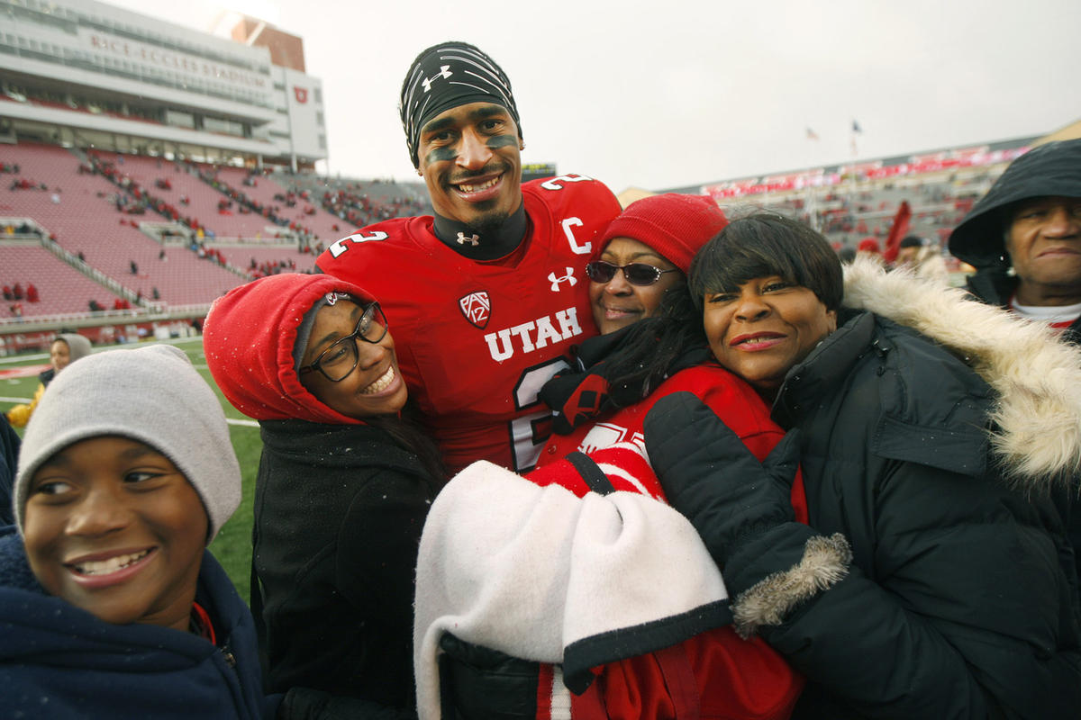 Utah Utes wide receiver Kenneth Scott (2) is surrounded by family after the game as Utah defeated Colorado 20-14 at Rice-Eccles Stadium in Salt Lake City Saturday, Nov. 28, 2015.