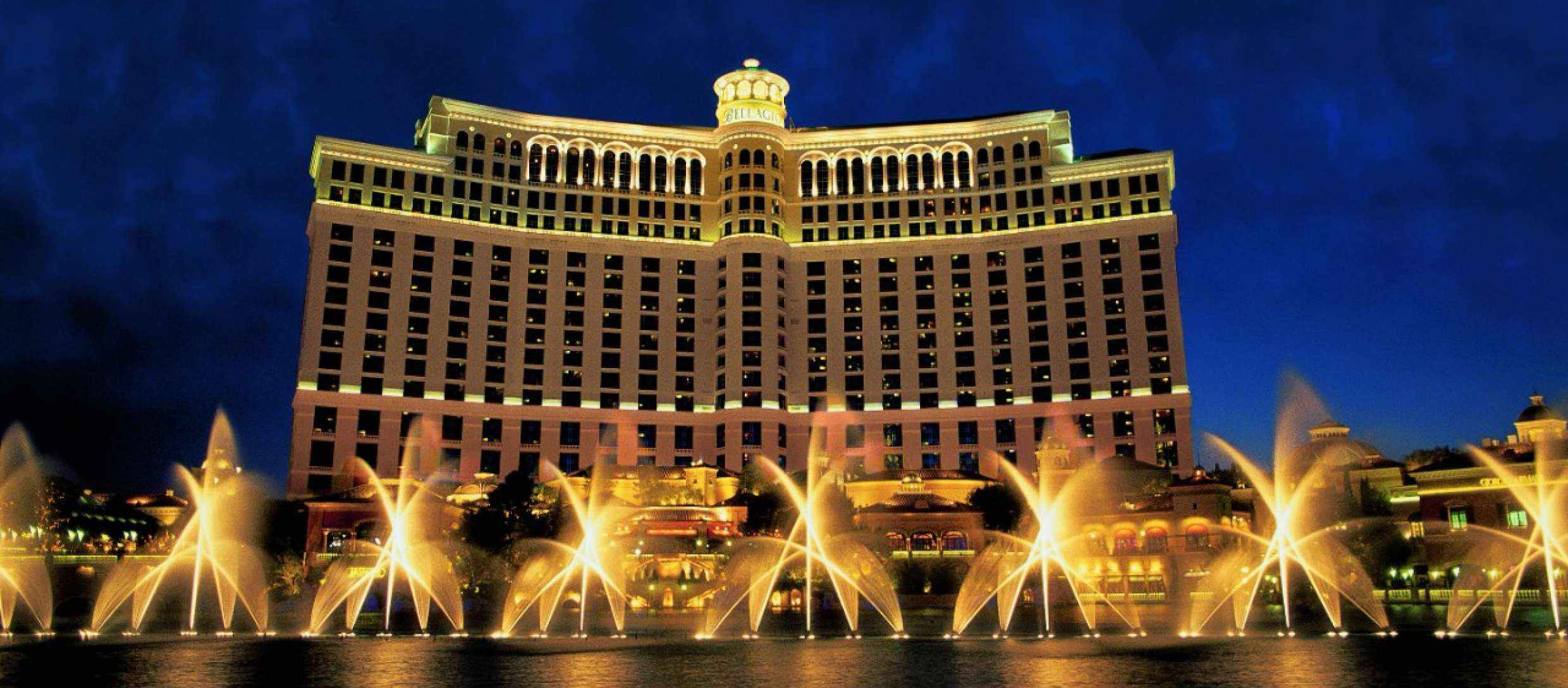 The exterior of a hotel with fountains