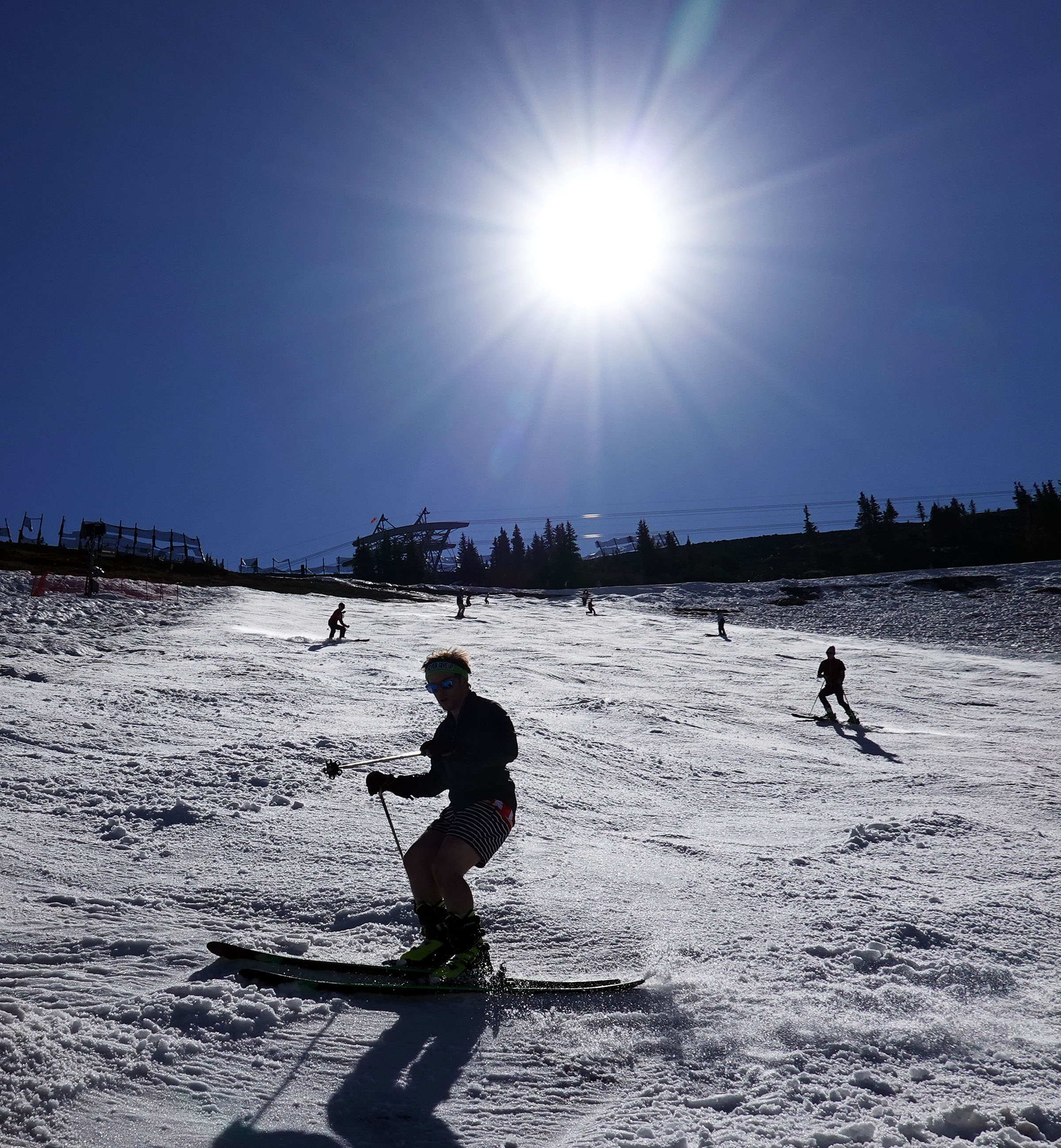 Skiers and snowboarders glide down the Regulator run at Snowbird on Thursday, July 4, 2019.