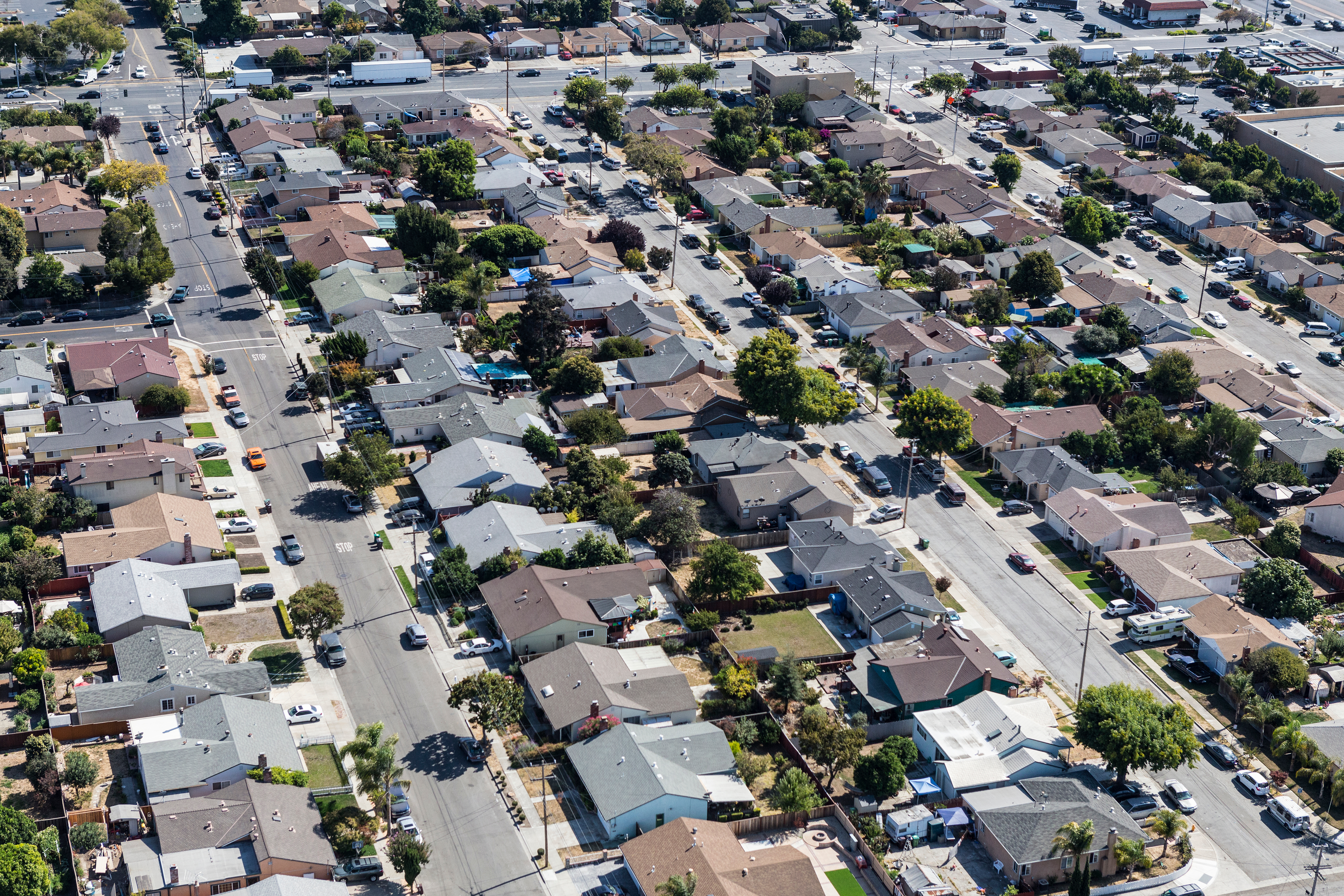 An overhead view of a neighborhood filled with single-family homes.