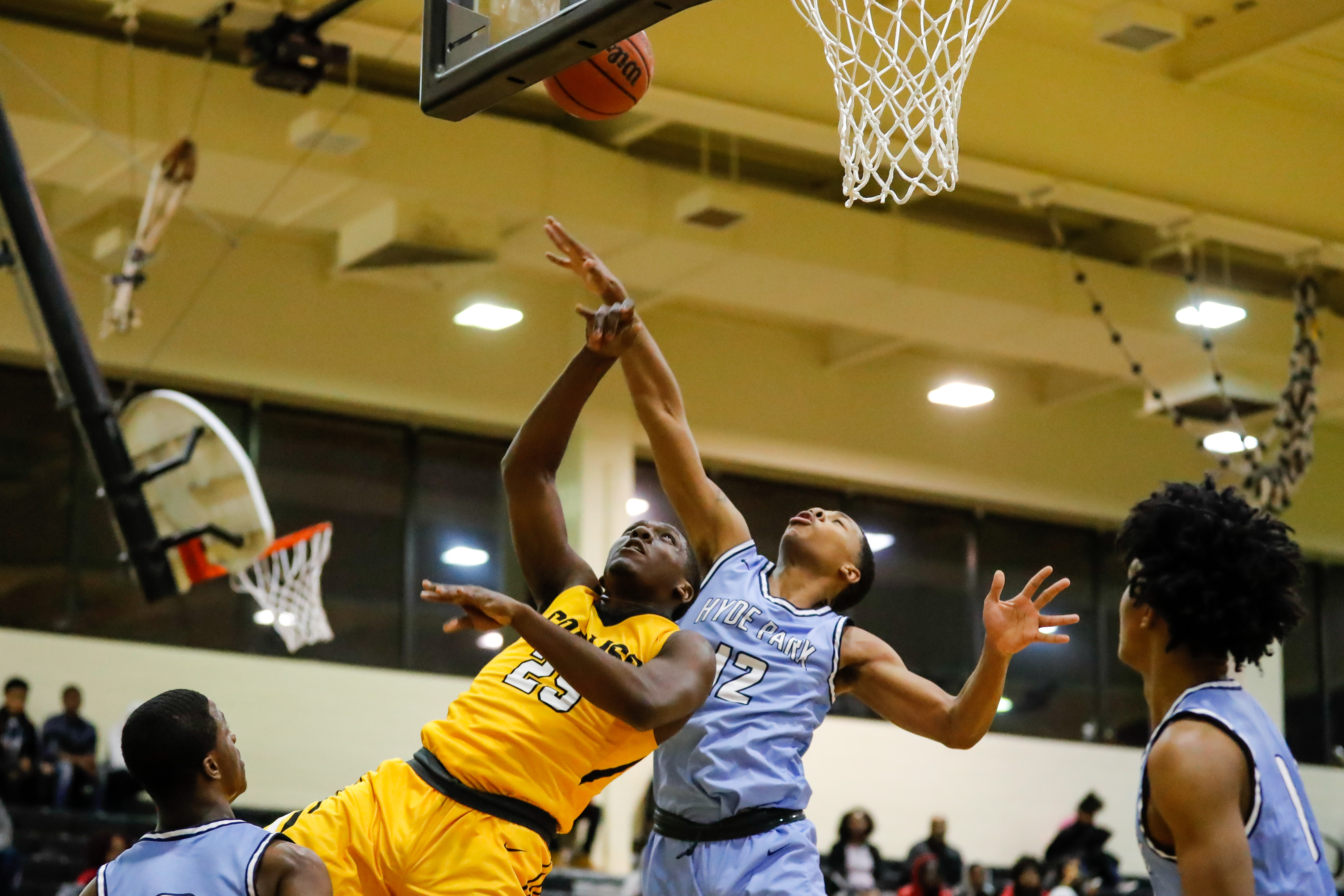 Hyde Park's Maurice Clay (12) goes up to block a shot from Corliss's Jayden Williams (25).