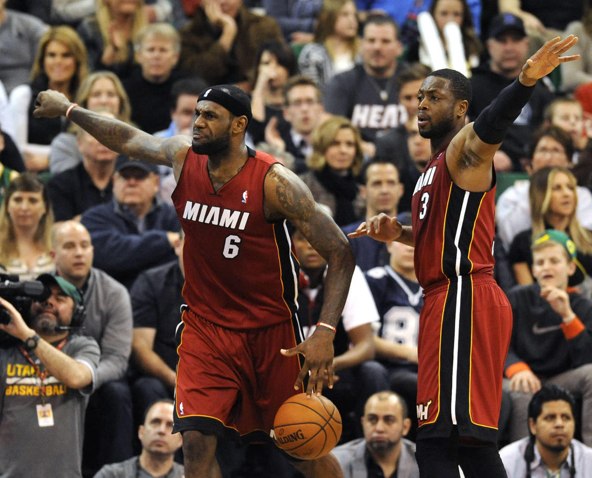 Miami Heat small forward LeBron James (6) and Miami Heat shooting guard Dwyane Wade (3) want an offensive foul call as James was called for the foul instead during a game at EnergySolutions Arena on Saturday, Feb. 8, 2014.