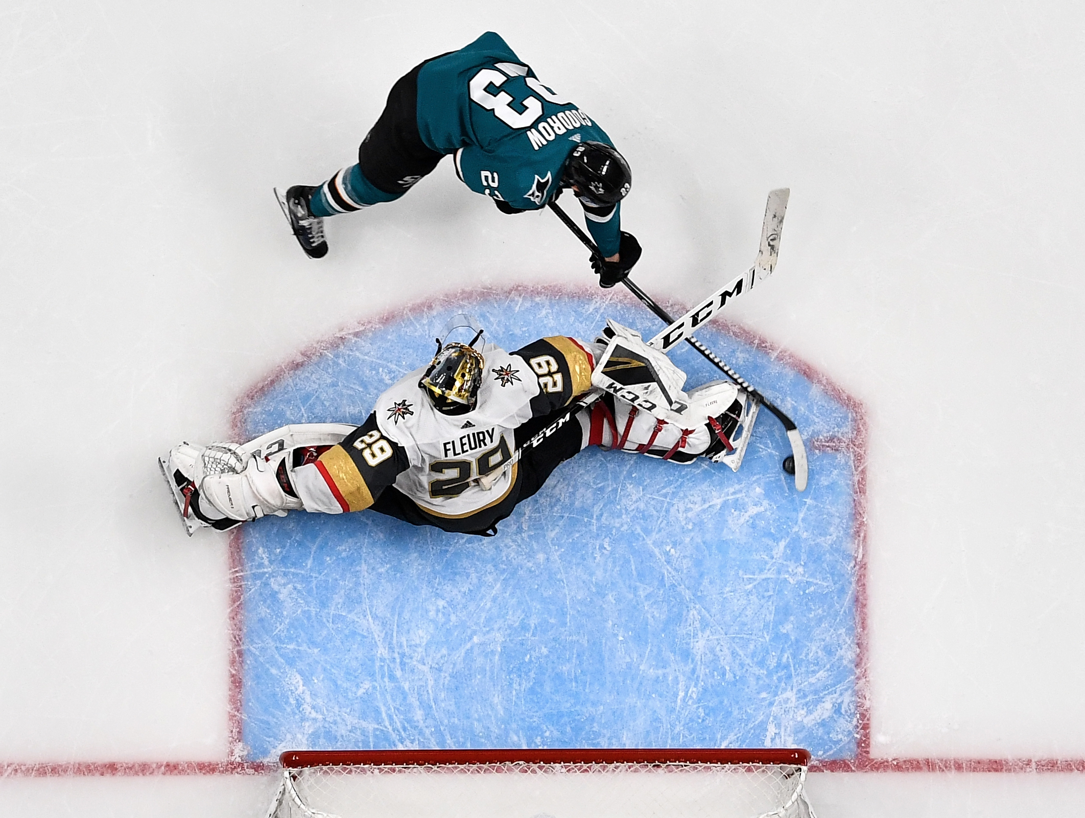 An overhead view as Barclay Goodrow #23 of the San Jose Sharks scores the game-winning goal against Marc-Andre Fleury #29 of the Vegas Golden Knights in Game 7 of the Western Conference First Round during the 2019 NHL Stanley Cup Playoffs at SAP Center on April 23, 2019 in San Jose, California
