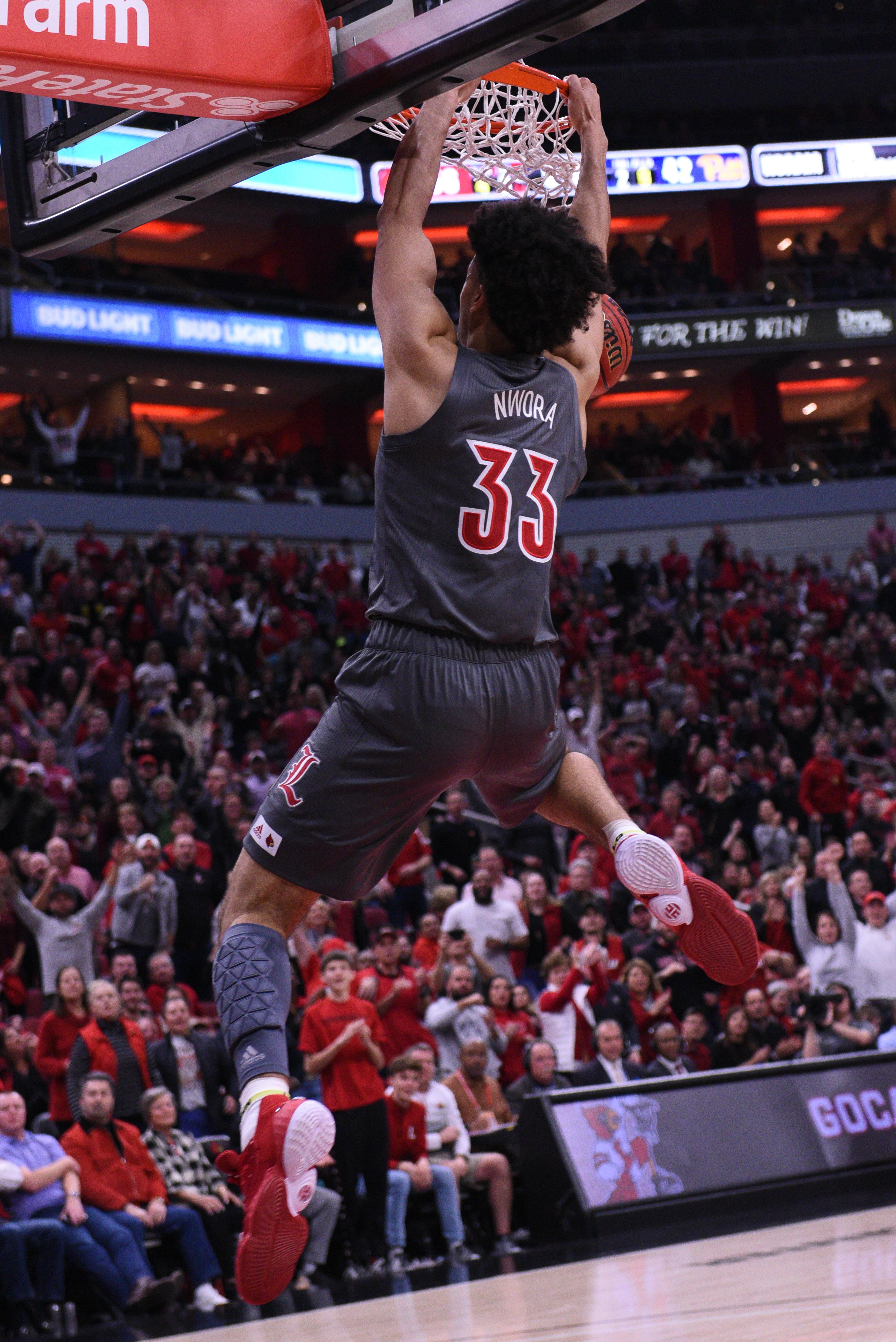 Jordan Nworra dunks in  the win over Pittsburgh.