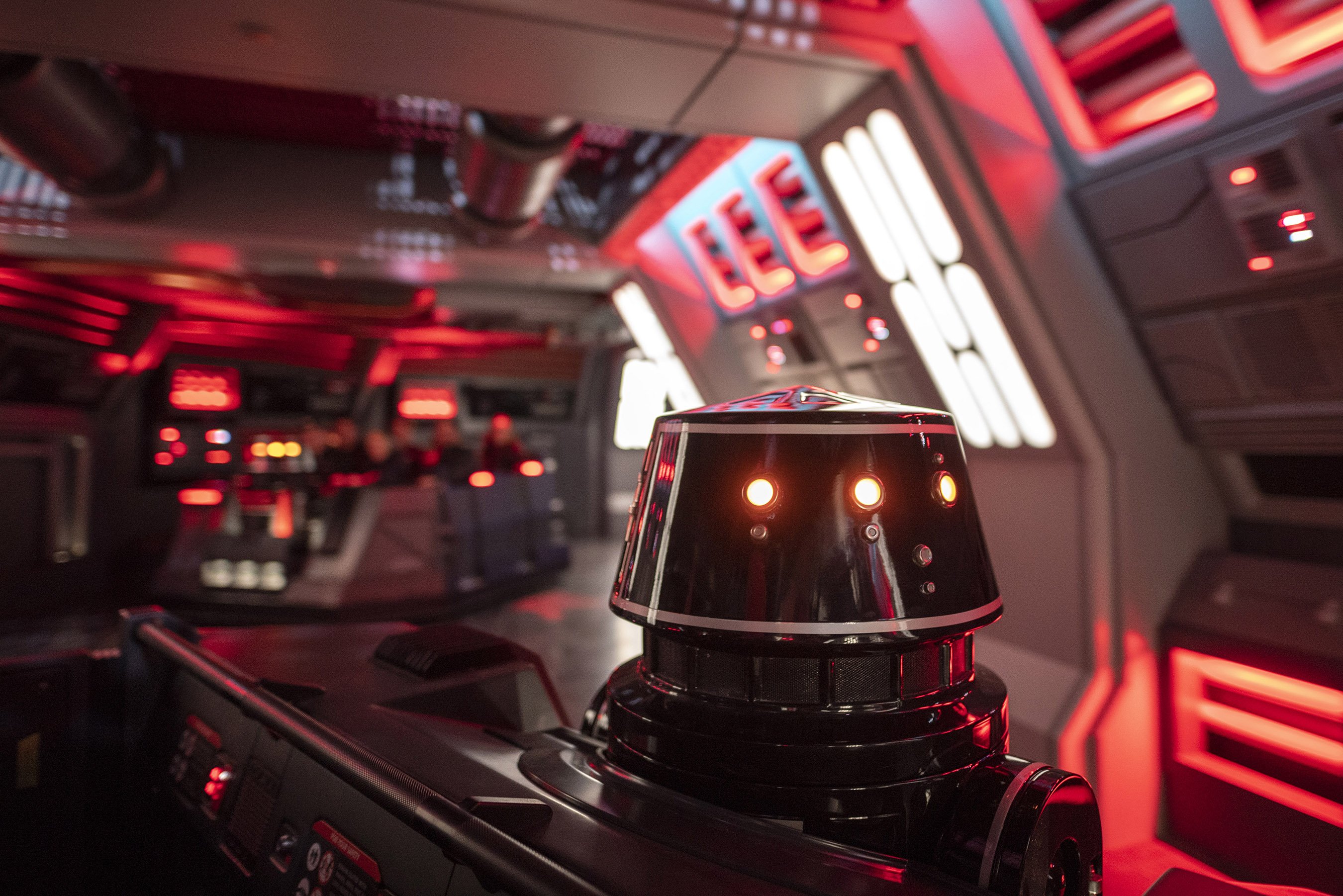 First Order R5-series astromech droids pilot troop transports onboard a Star Destroyer in Star Wars: Rise of the Resistance.