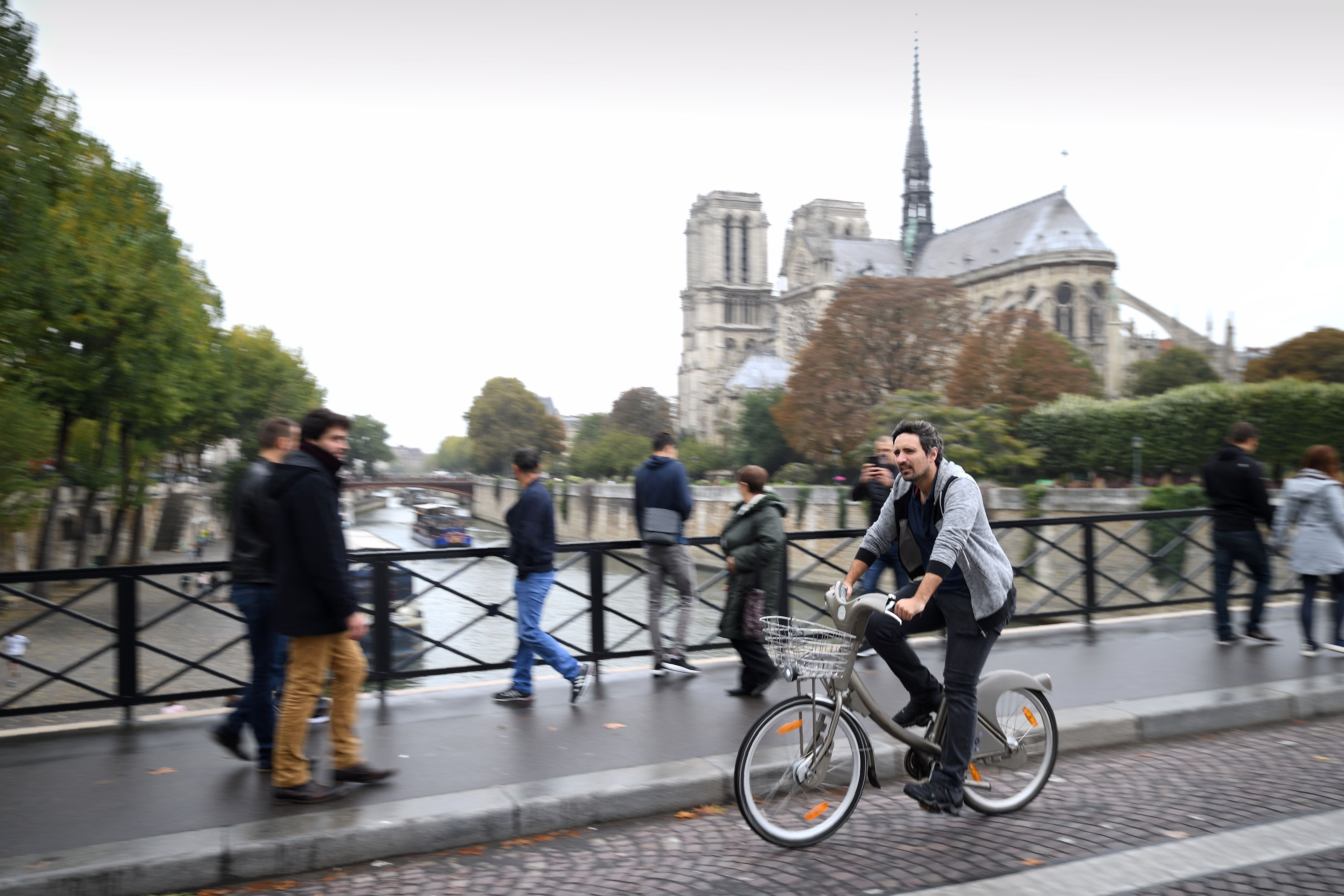 Cycling past Notre Dame Cathedral