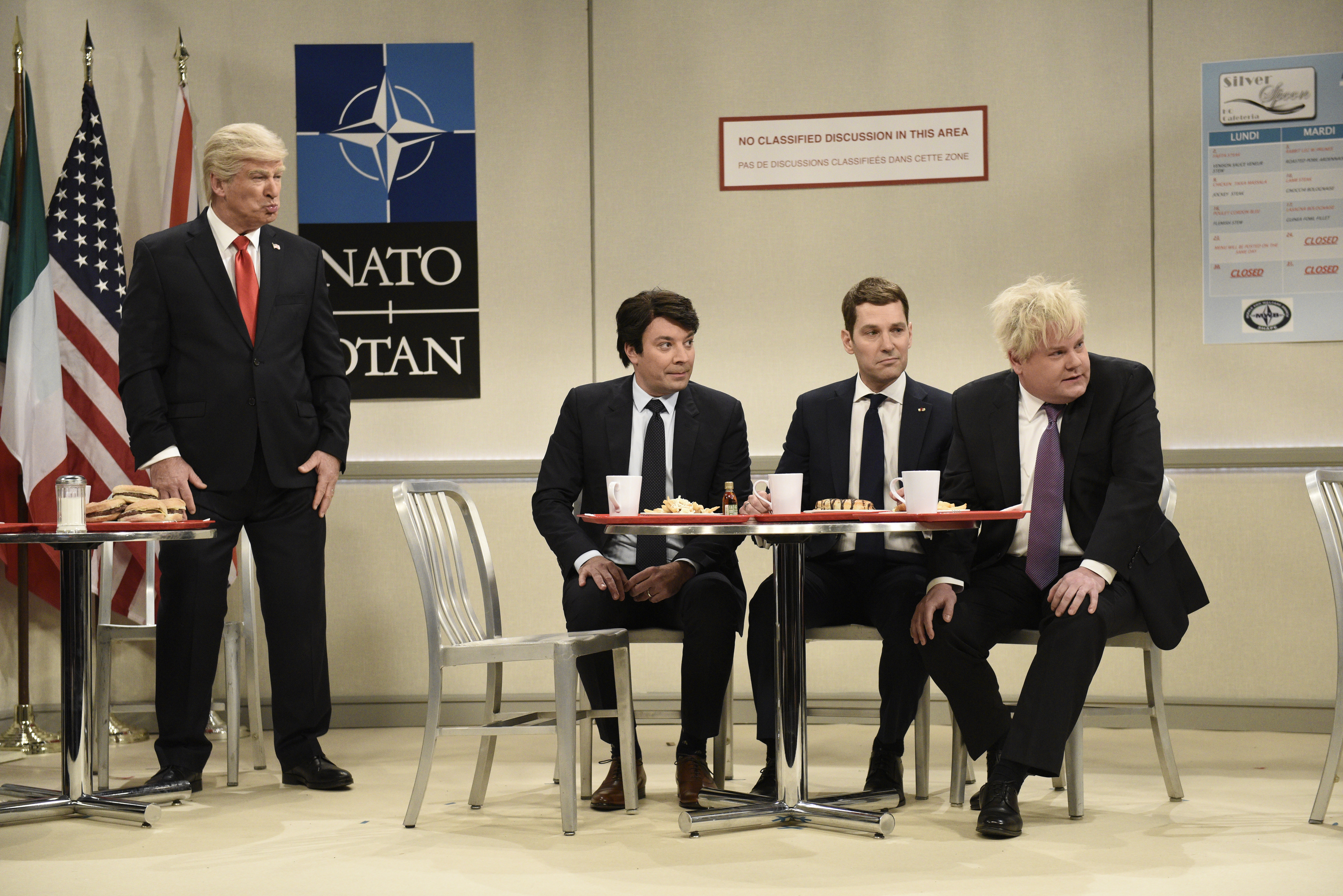 Alec Baldwin — as Donald Trump — speaks with Jimmy Fallon's Justin Trudeau, Paul Rudd's Emmanuel Macron, and James Corden's Boris Johnson at a NATO summit.