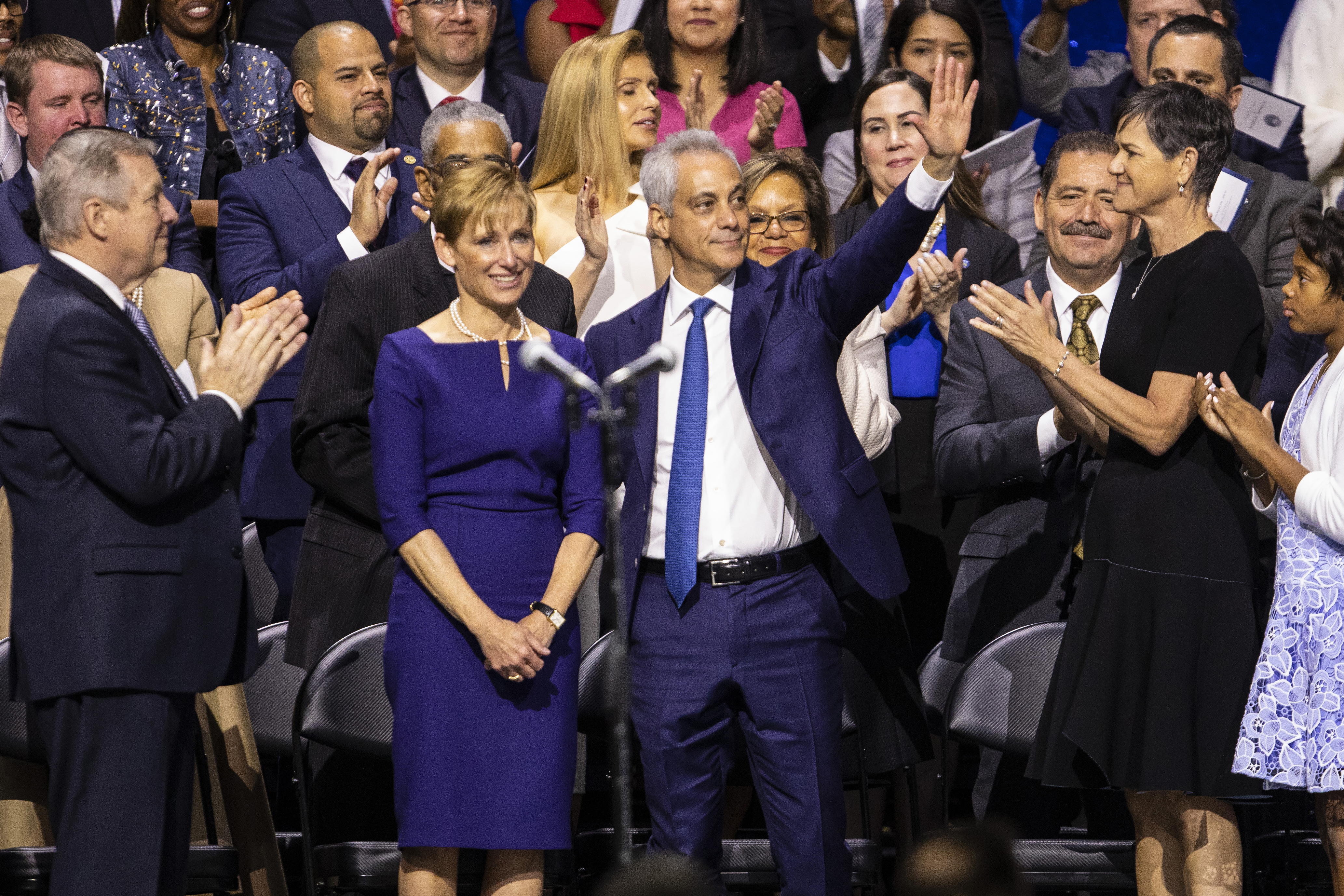 Former Mayor Rahm Emanuel and his wife Amy Rule are applauded for their service to the city during the inauguration ceremony for Lori Lightfoot at the Wintrust Arena on May 20, 2019. Emanuel, in an edgy speech at the Gridiron Club and Foundation winter dinner Saturday, Dec. 7, took some swings at ex-New York Mayor Michael Bloomberg.