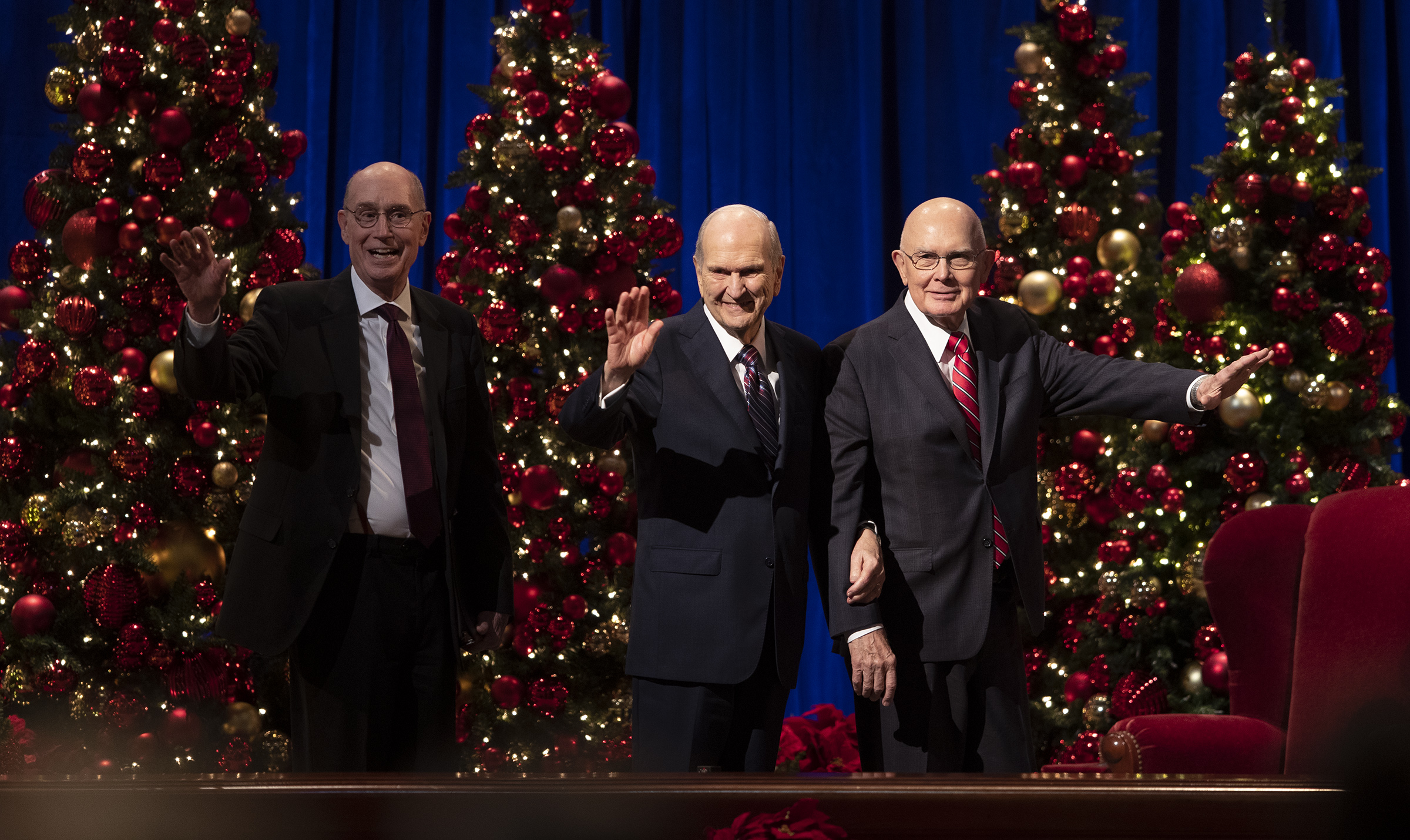 President Henry B. Eyring, second counselor in the First Presidency of The Church of Jesus Christ of Latter-day Saints, President Russell M. Nelson and President Dallin H. Oaks, first counselor in the First Presidency, wave as they leave the First Presidency Christmas Devotional at the Conference Center in Salt Lake City on Sunday, Dec. 8, 2019.