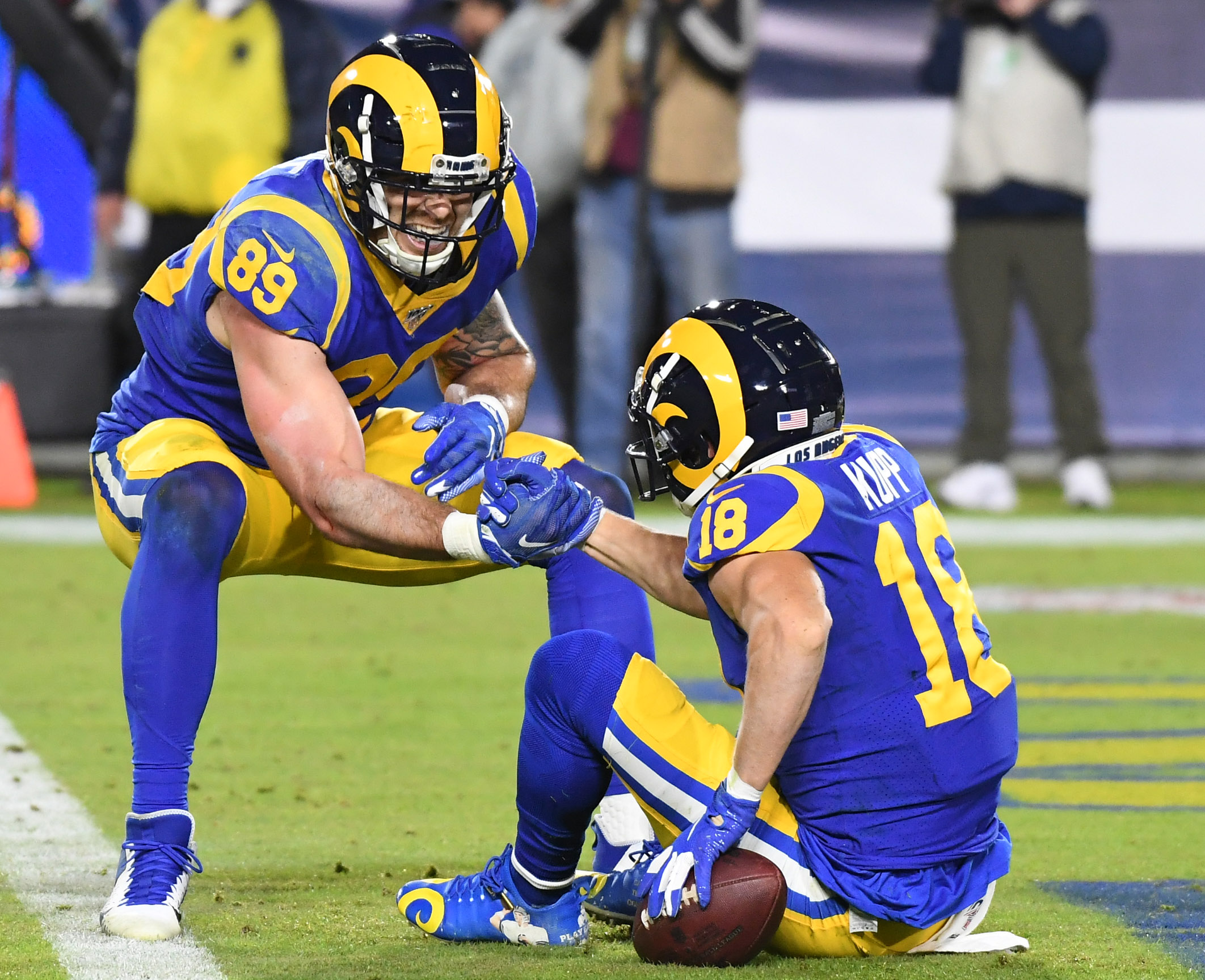 Los Angeles Rams TE Tyler Higbee helps WR Cooper Kupp after scoring a touchdown against the Seattle Seahawks in Week 14, Dec. 8, 2019.