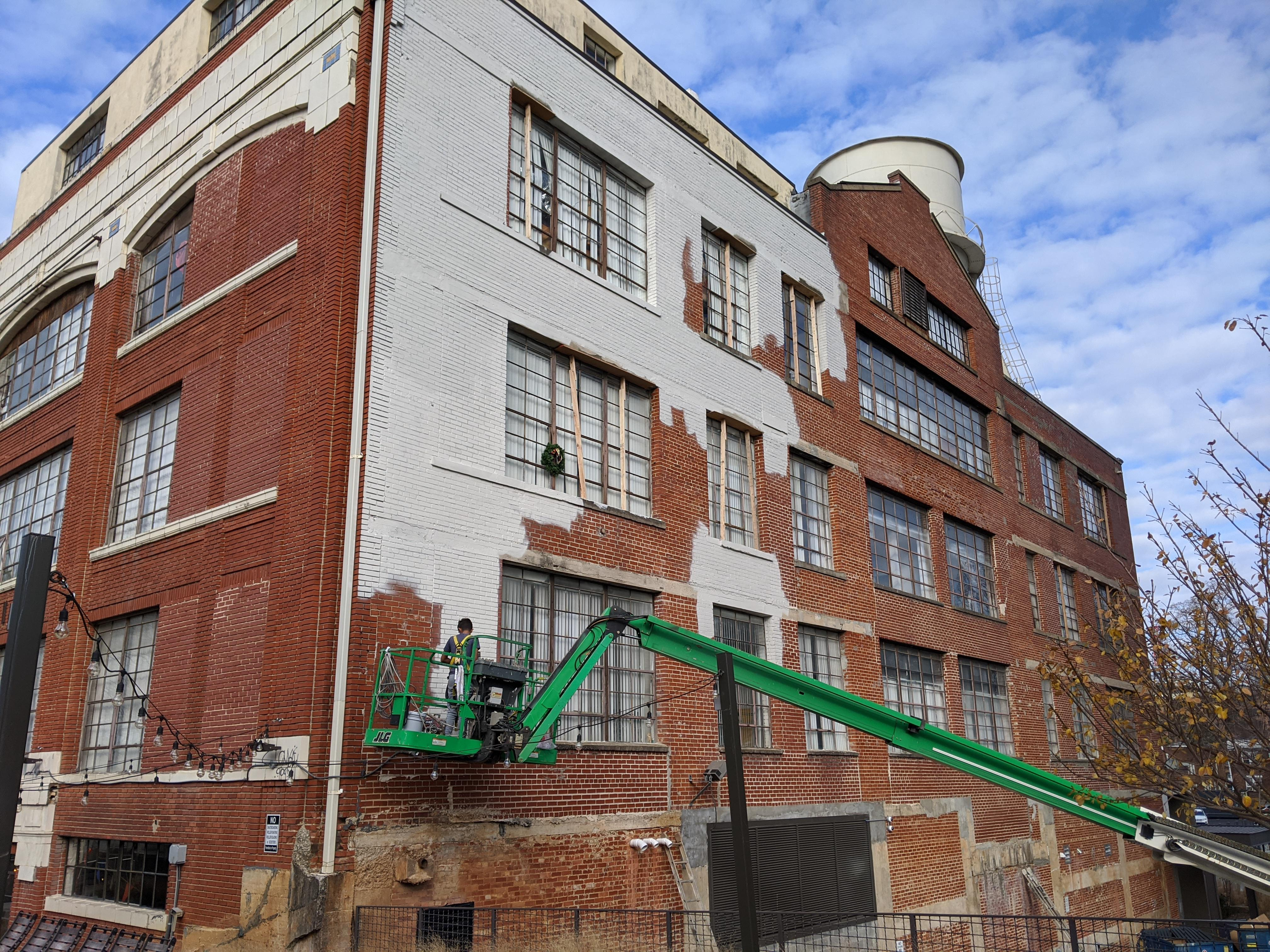 As 725 Ponce offices debut next door, Ford Factory Lofts updates rile preservationists