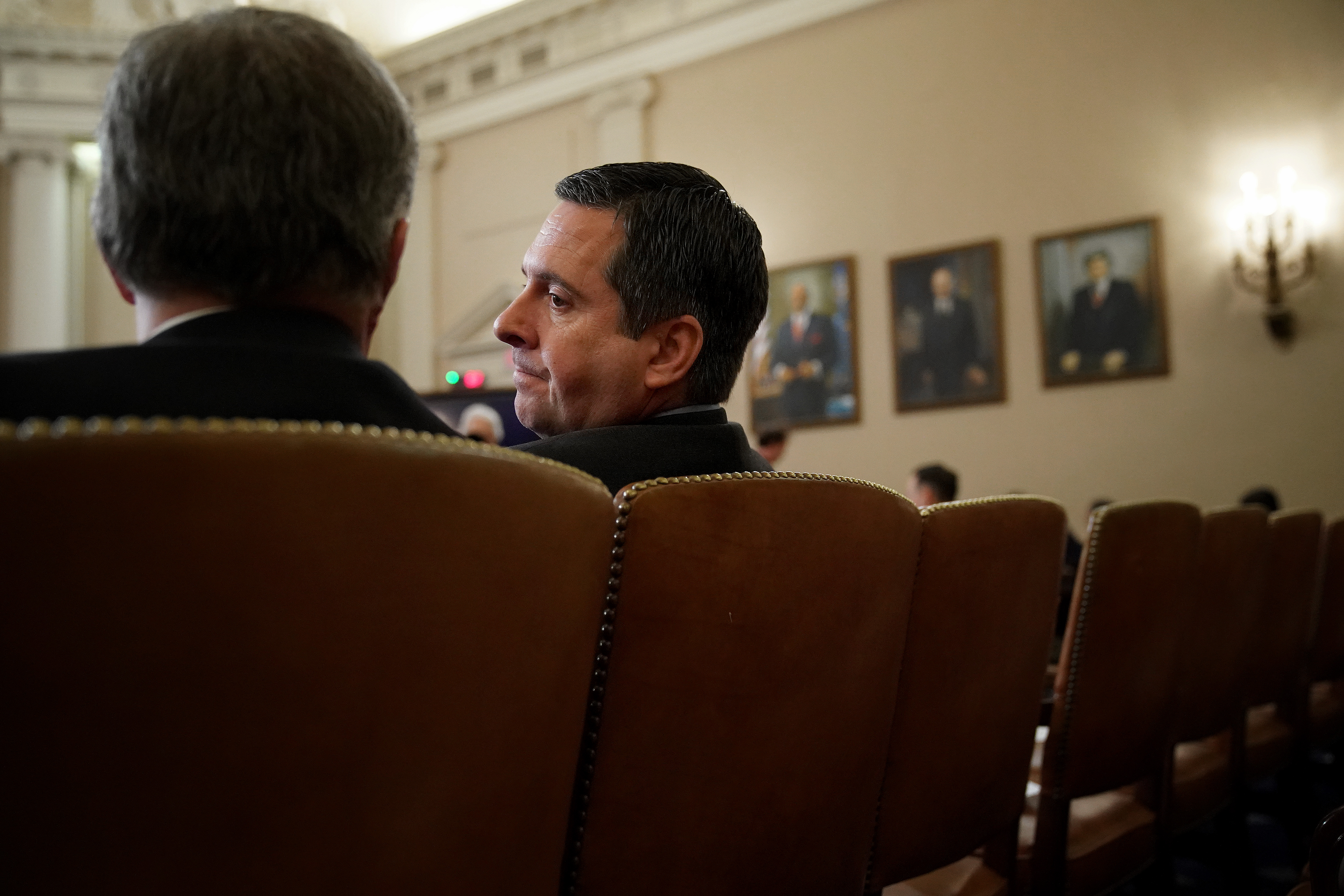 Devin Nunes sits in profile in the Longworth House Office Building.