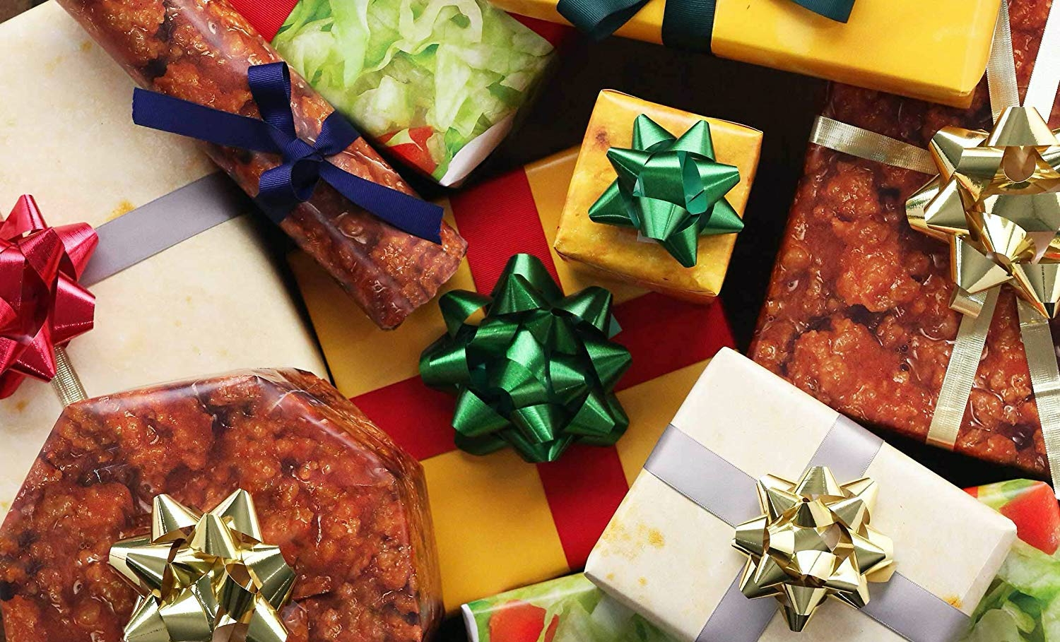 A spread of presents adorned with bows and wrapped with paper that looks like the ingredients of a Taco Bell Crunchwrap.