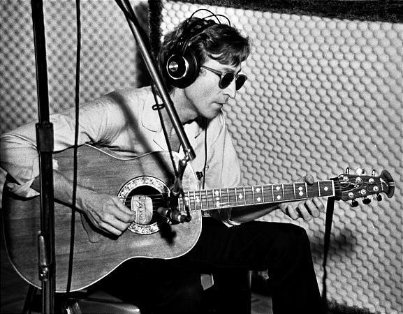 John Lennon in the recording studio.