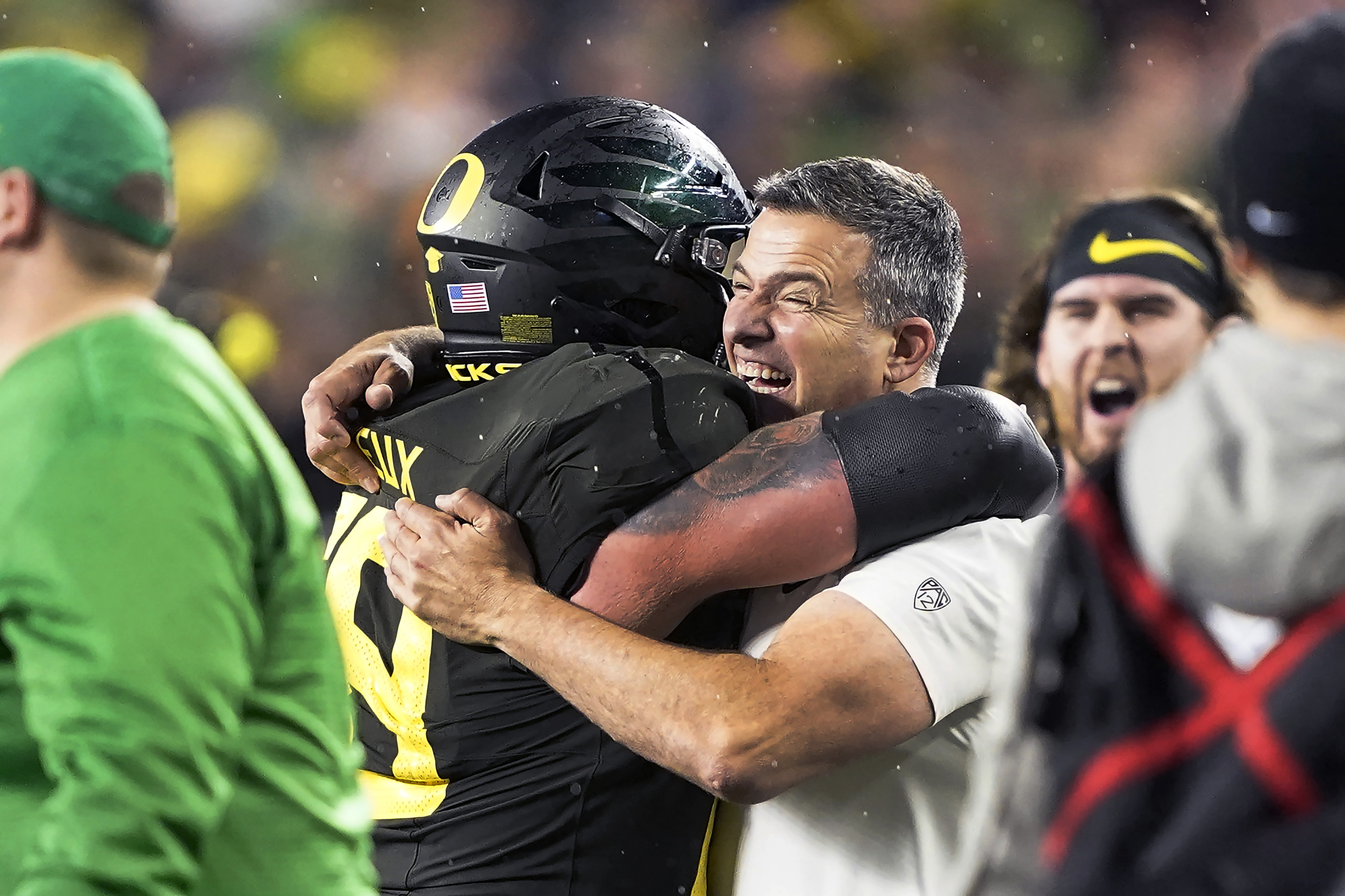 Oregon coach Mario Cristobal celebrates with offensive lineman Shane Lemieux after the Ducks defeated Utah in the Pac-12 Championship Game.