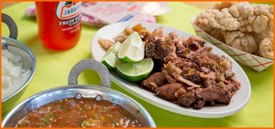 Carnitas Uruapan's signature dish with beans and Jaritos.