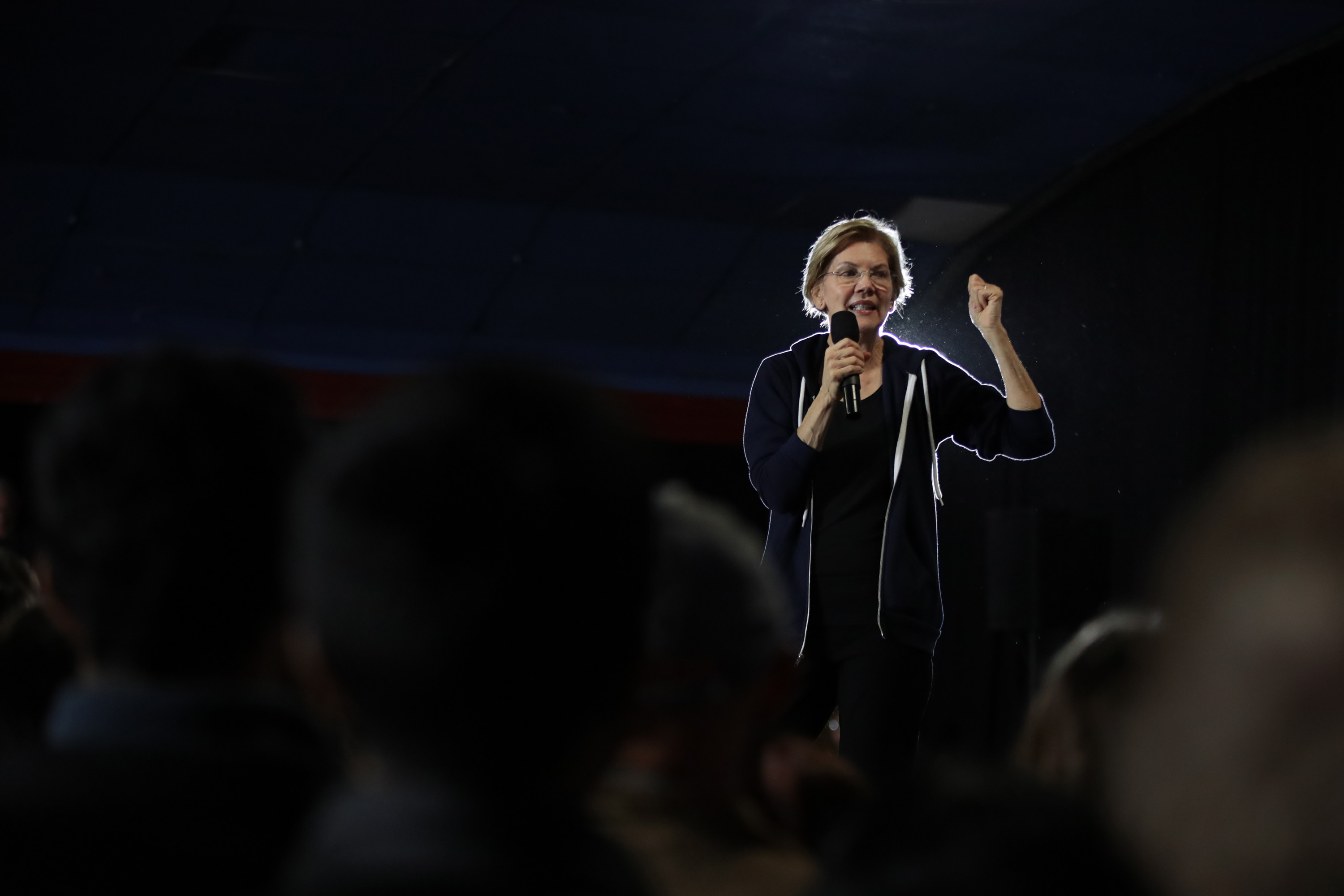 Elizabeth Warren on stage surrounded by a crowd at a campaign stop in Des Moines, Iowa in November 2019.