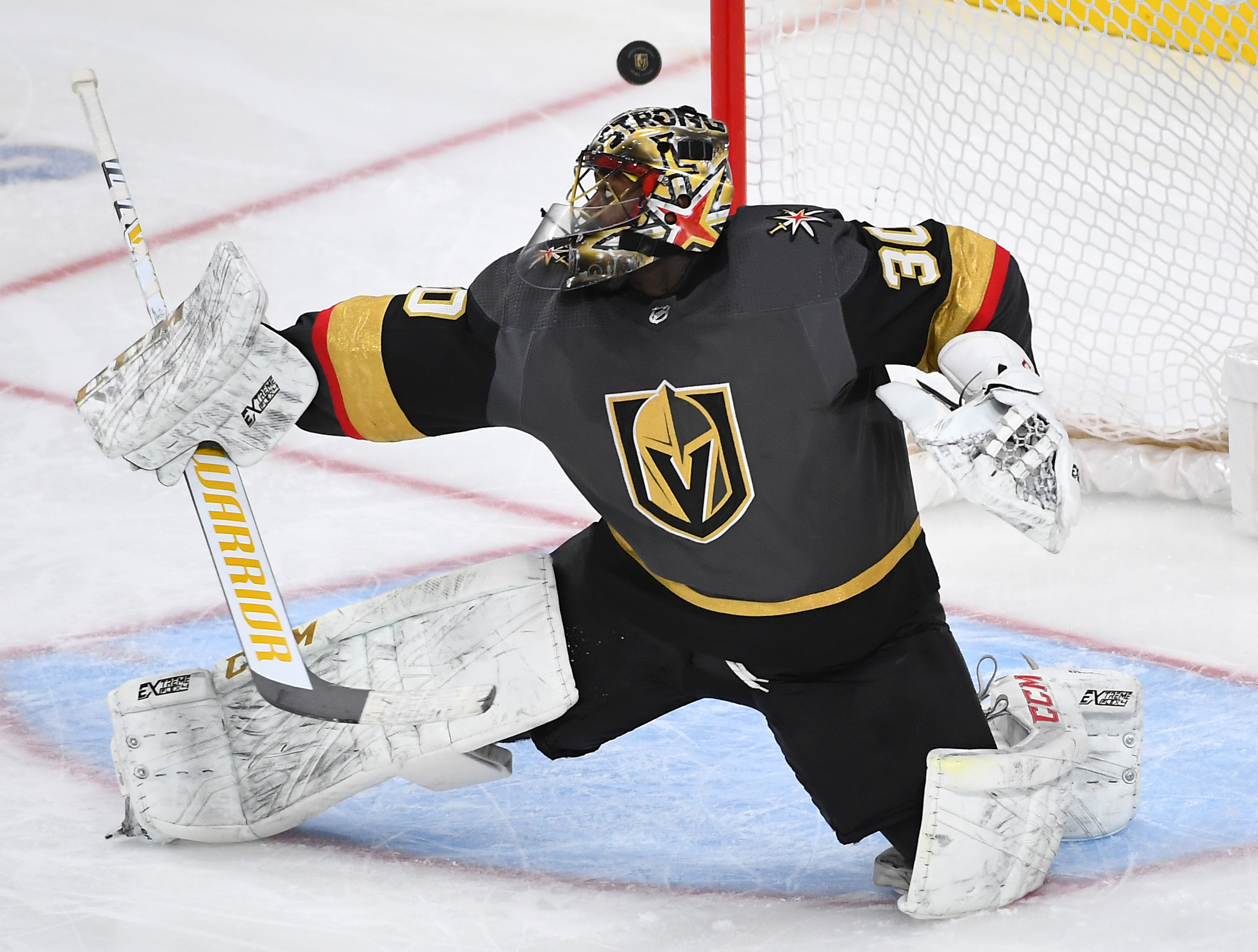 Dec 8, 2019; Las Vegas, NV, USA; Vegas Golden Knights goaltender Malcolm Subban (30) reaches to deflect a shot that goes wide of his net during the third period against the New York Rangers at T-Mobile Arena.