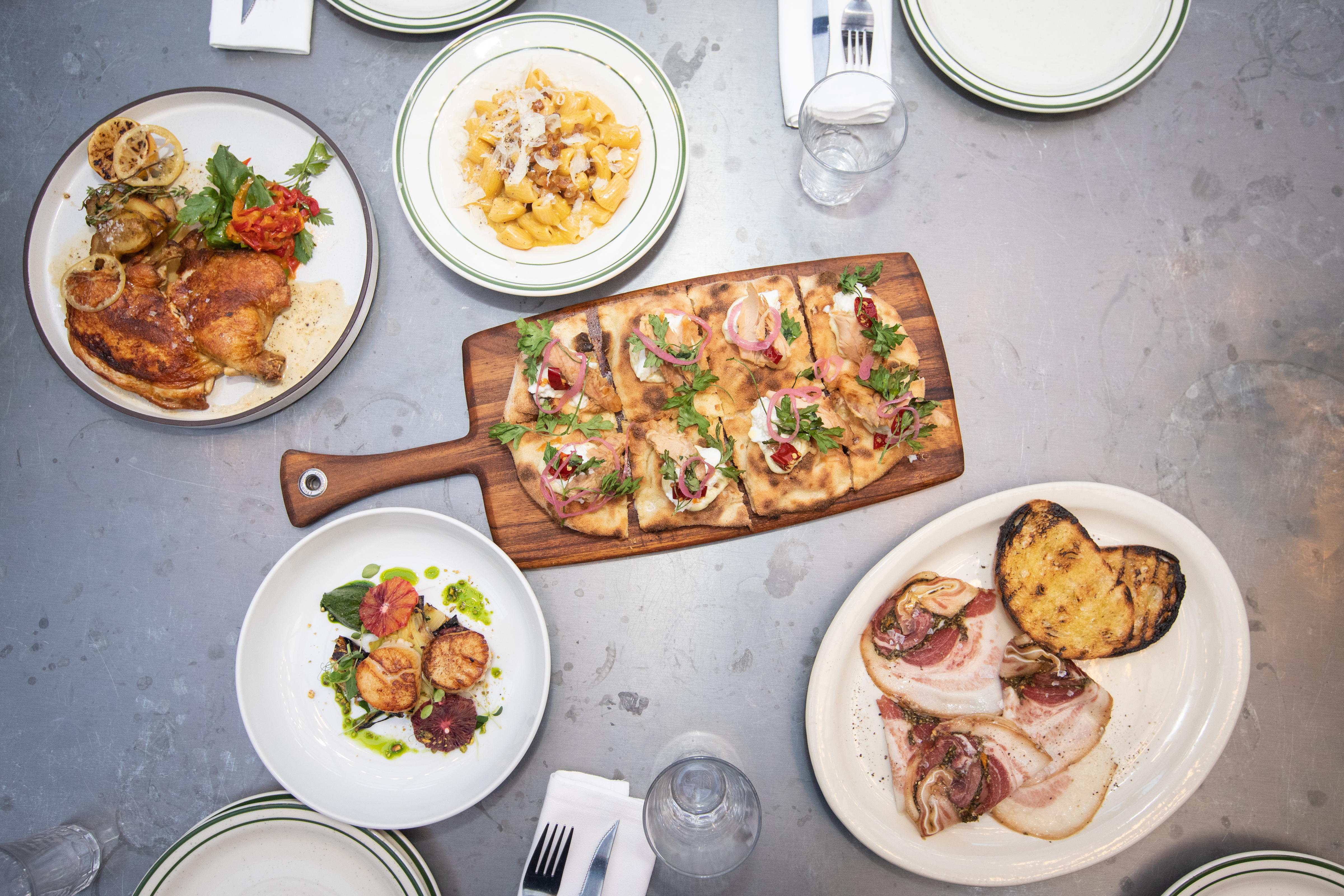 Four dishes laid out on a table top.