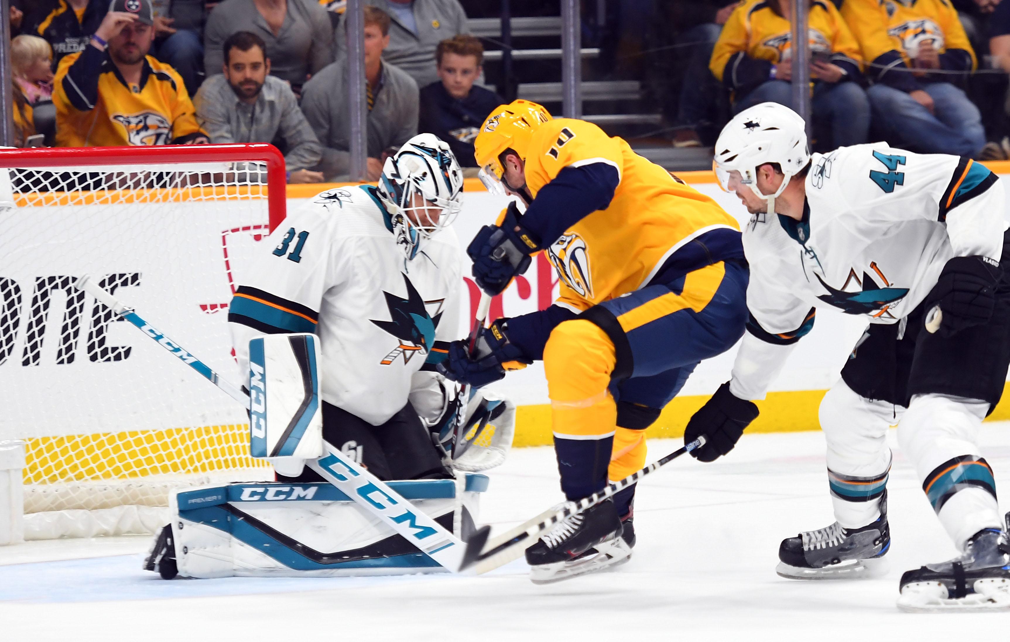 Oct 8, 2019; Nashville, TN, USA; San Jose Sharks goaltender Martin Jones (31) makes a save on a shot attempt from Nashville Predators center Colton Sissons (10) during the first period at Bridgestone Arena.