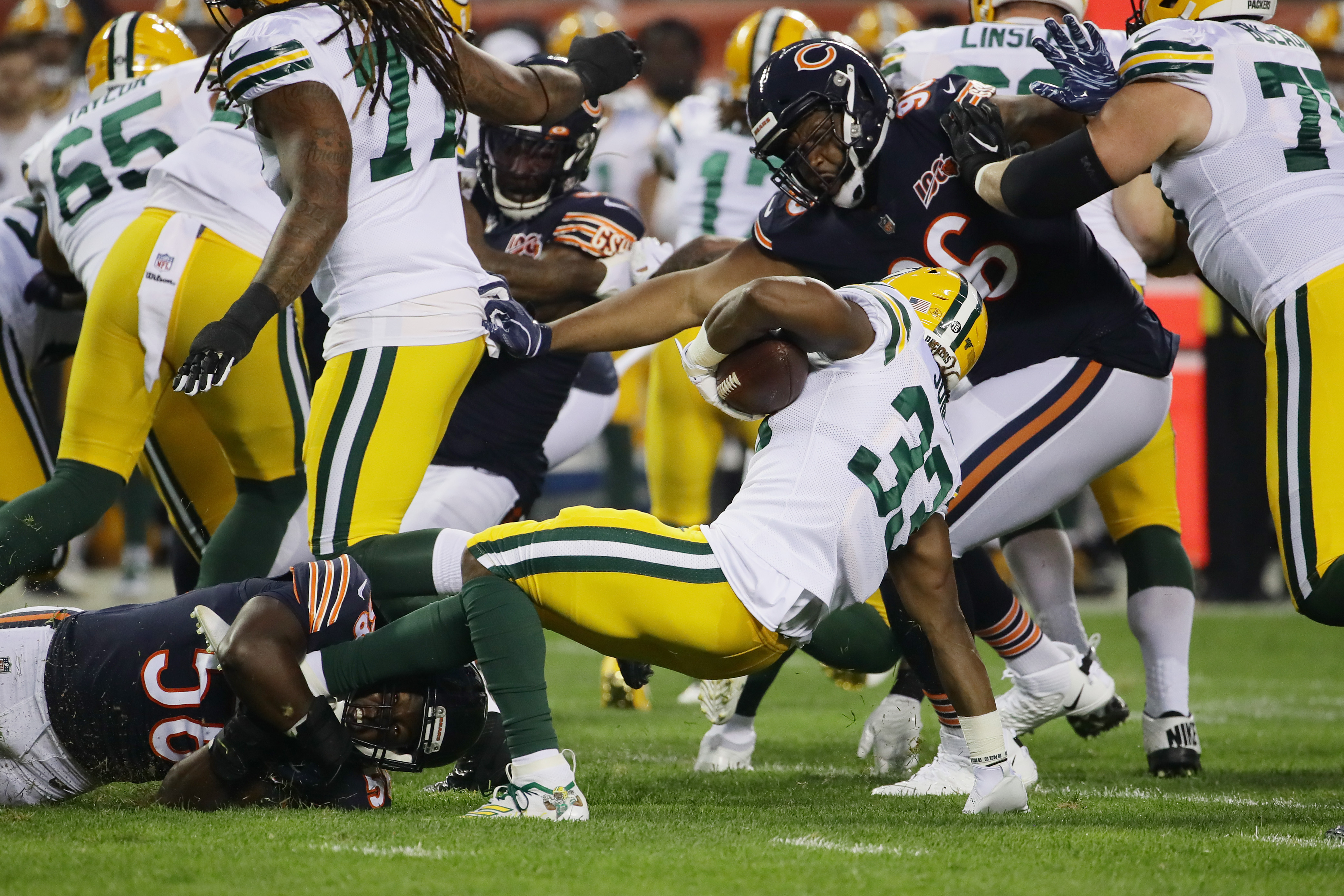 Bears linebacker Roquan Smith (58, tackling Packers running back Aaron Jones in the season opener) had double-digit tackles in four of five games before suffering a season-ending torn pectoral muscle against the Cowboys last Thursday night.
