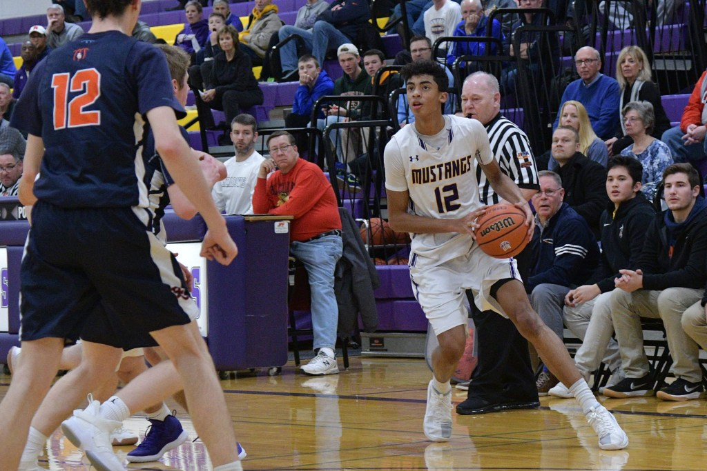 Rolling Meadows Max Christie lines up a three-point shot.