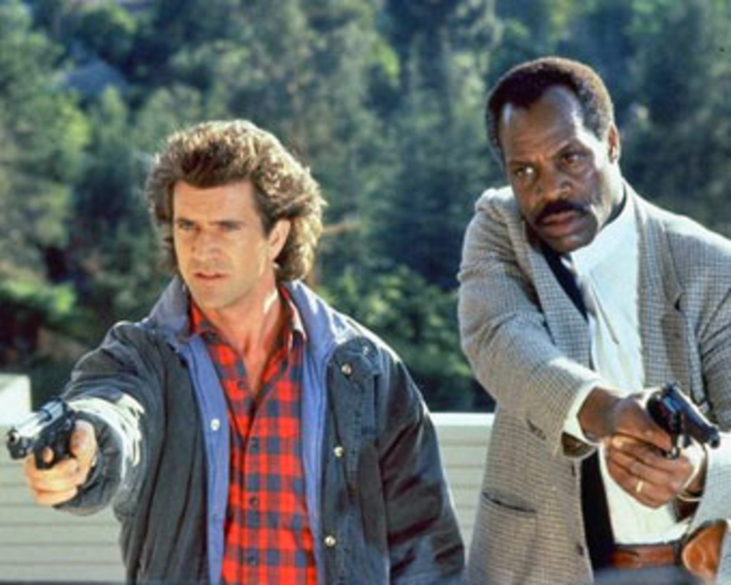 "Suicidal detective Martin Riggs (Mel Gibson, left) is paired with LAPD veteran Roger Murtaugh (Danny Glover) in the 1987 movie ""Lethal Weapon."""