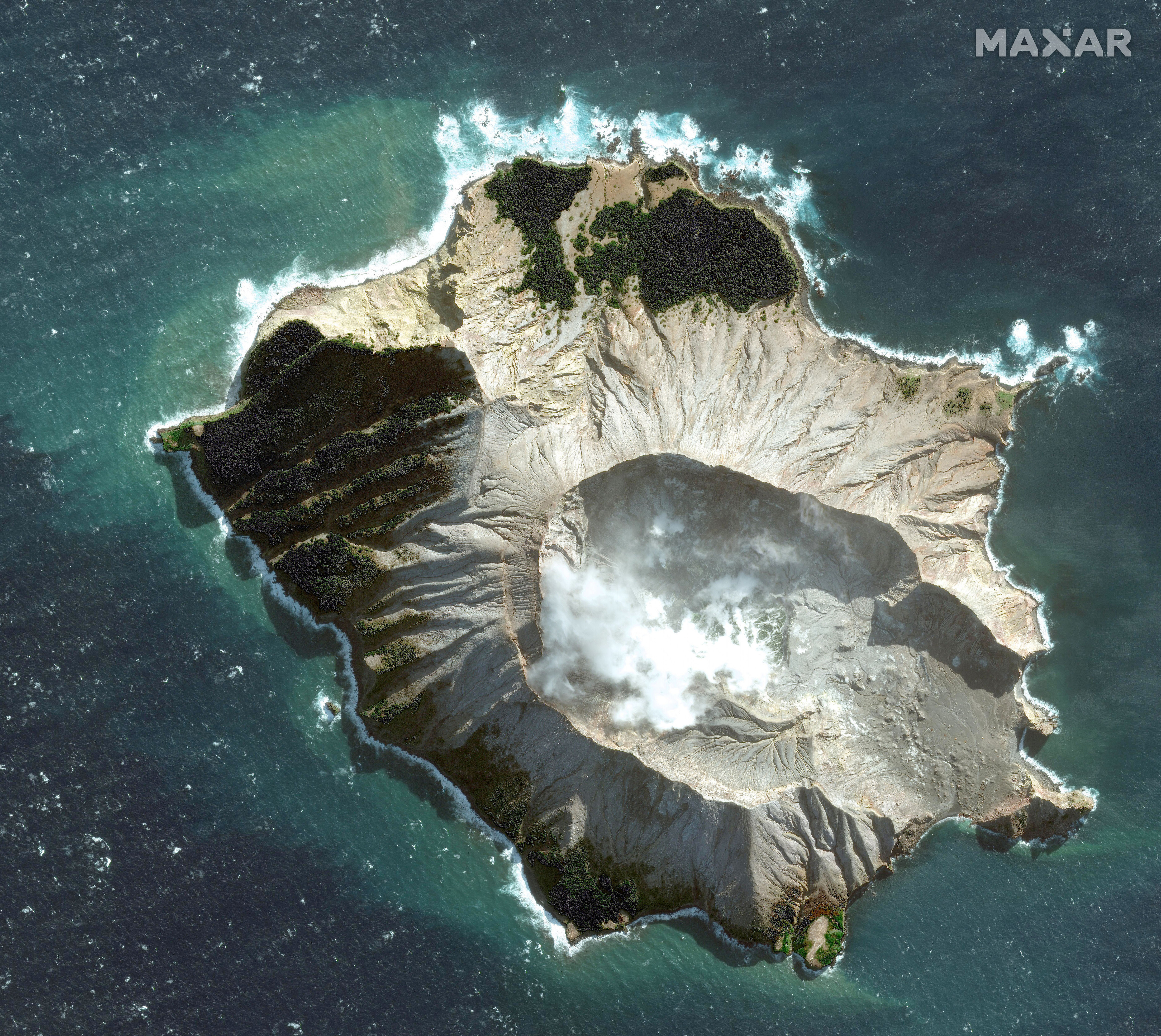 This May 12, 2019 satellite image provided by Maxar Technologies shows White Island in New Zealand before a volcano erupted on Monday, Dec. 9. (Satellite image ©2019 Maxar Technologies via AP)