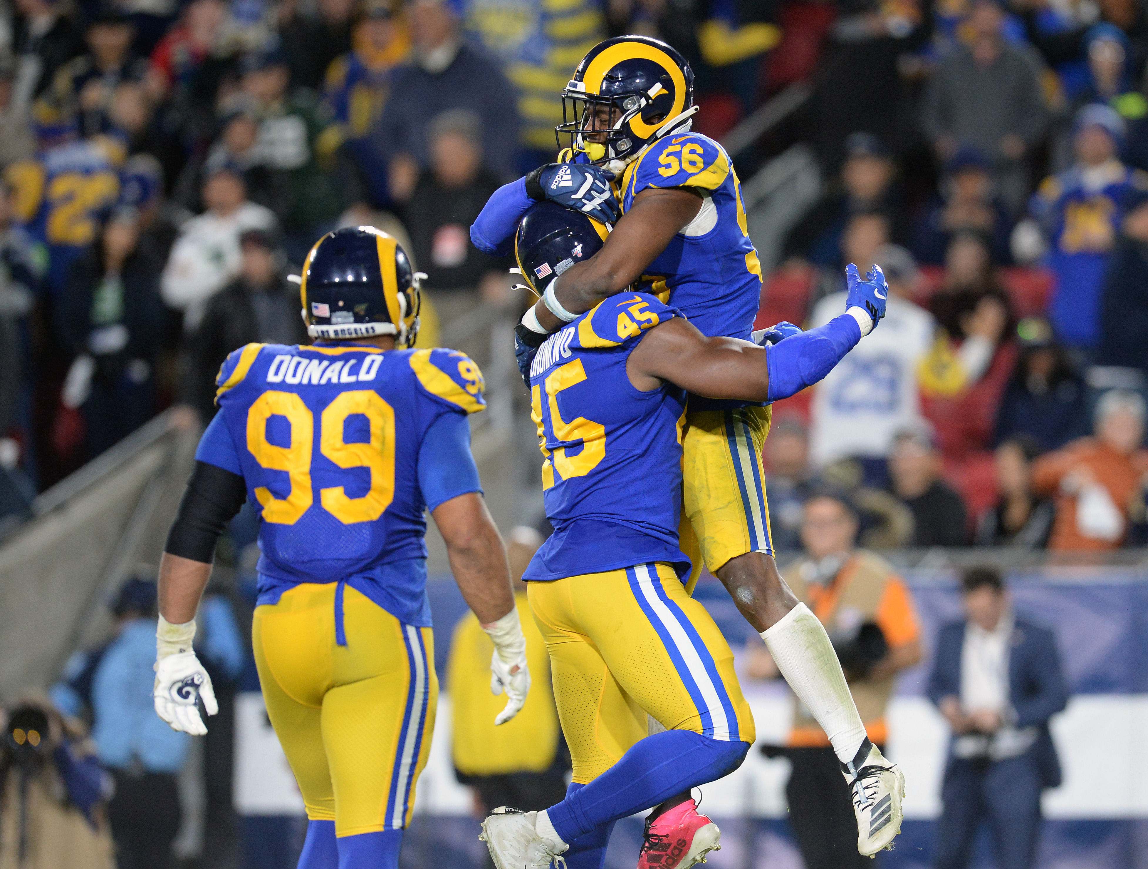 Los Angeles Rams EDGE Dante Fowler, Jr., celebrates with EDGE Ogbonnia Okoronkwo and DL Aaron Donald after sacking Seattle Seahawks QB Russell Wilson in Week 14, Dec. 8, 2019.