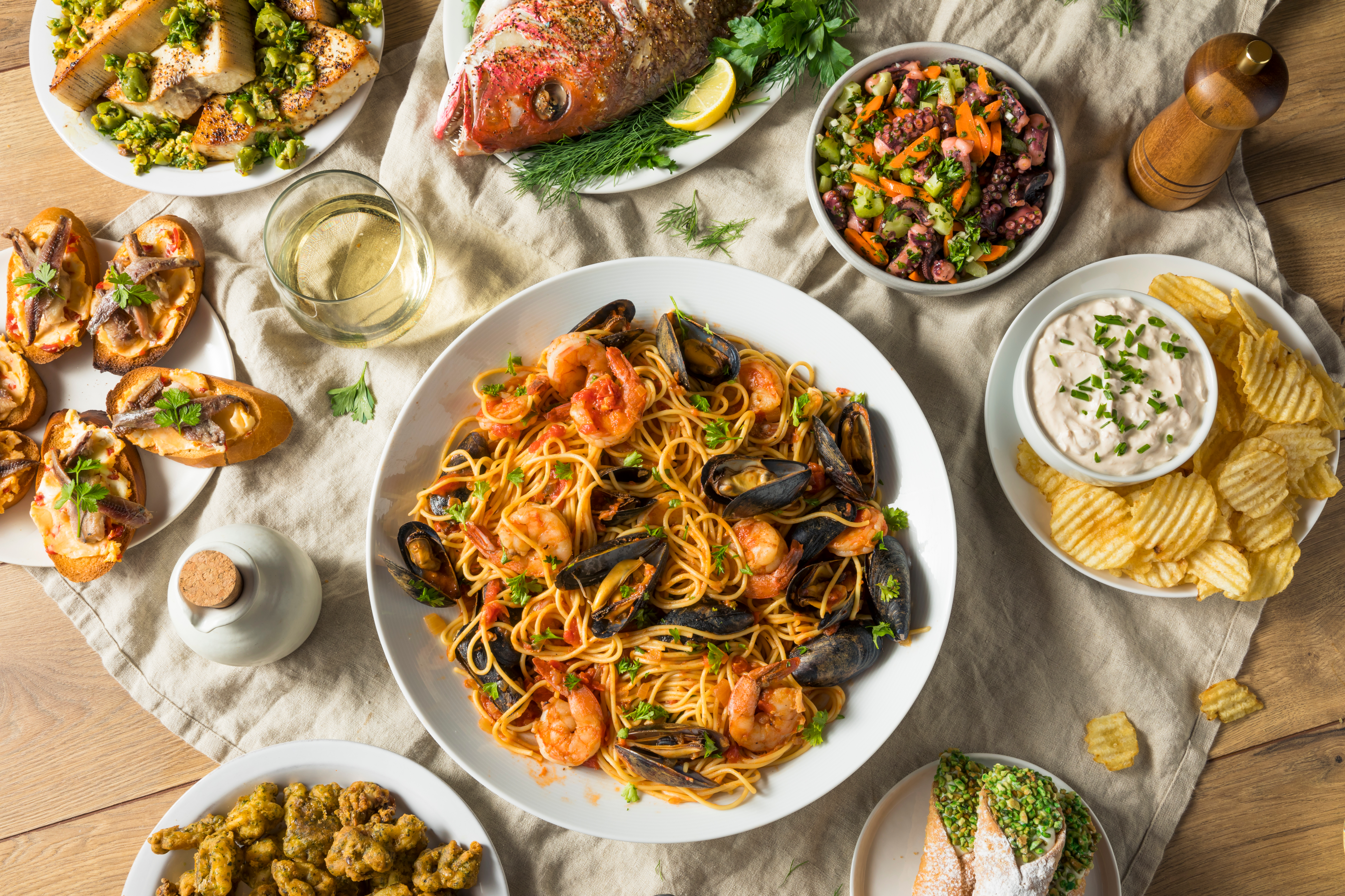 An array of dishes for the Feast of the Seven Fishes