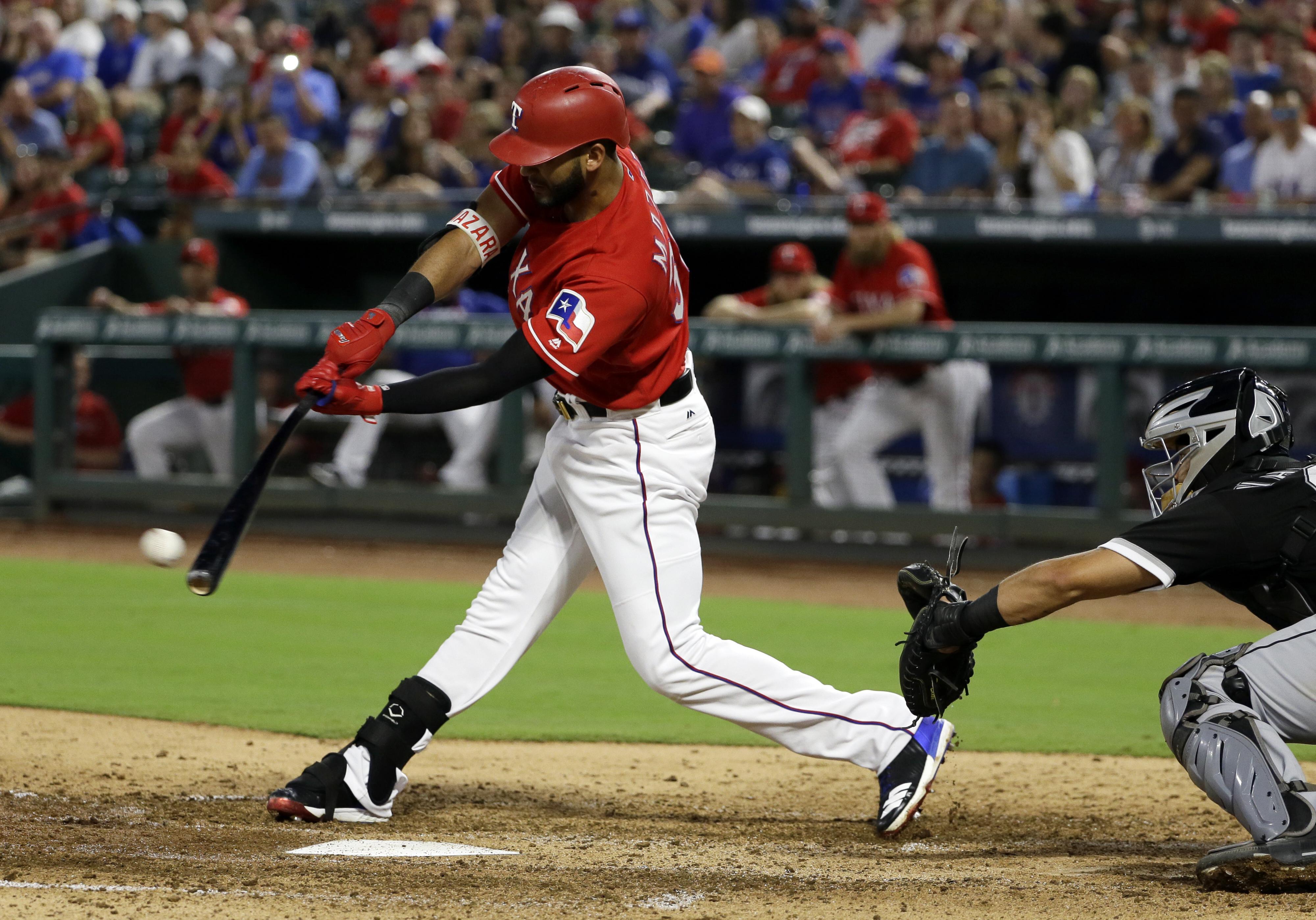 Texas Rangers' Nomar Mazara connects for a two-run single against the White Sox in 2017, in Arlington, Texas. (AP)