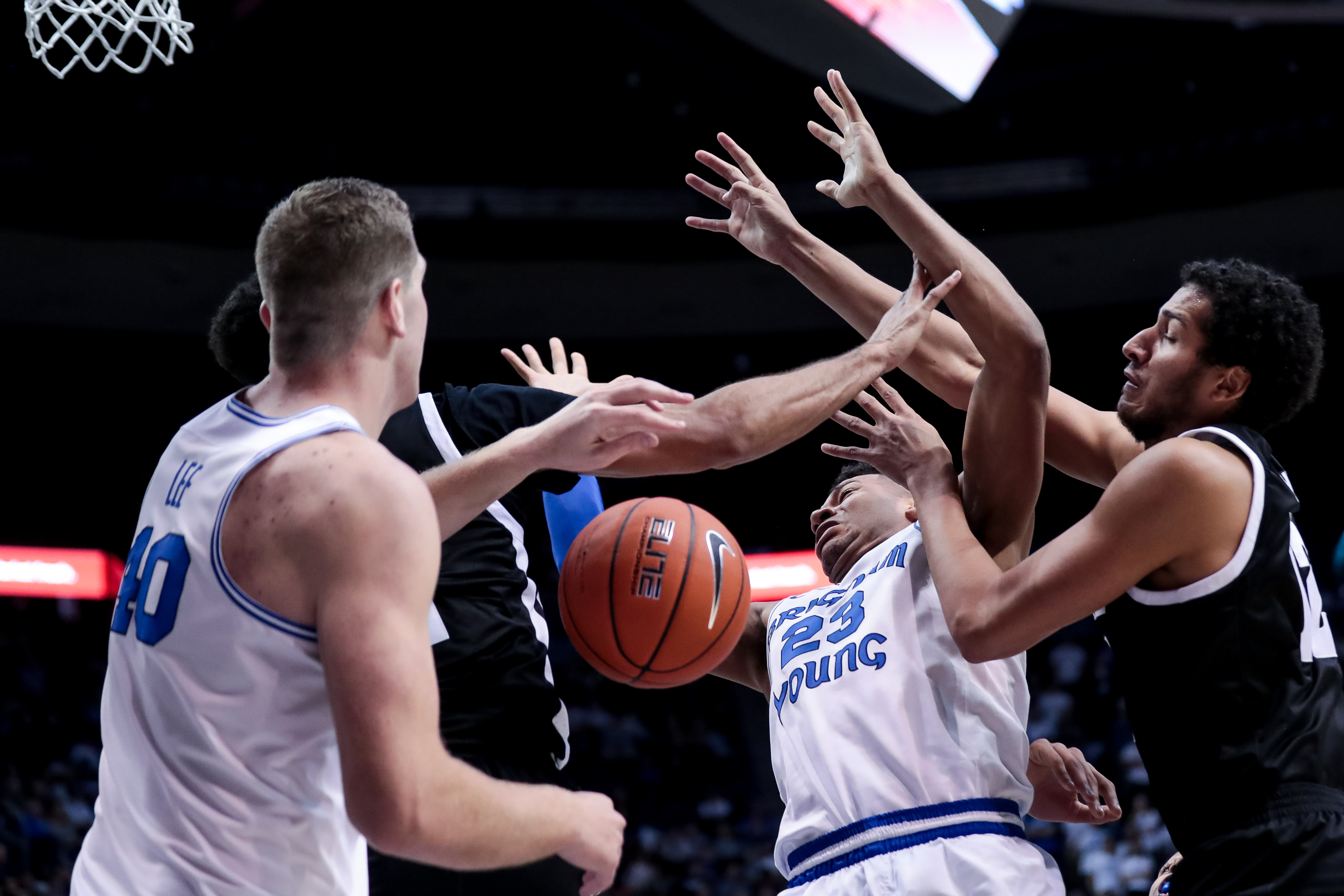 Nevada Wolf Pack forward Johncarlos Reyes (12) fouls Brigham Young Cougars forward Yoeli Childs (23) during the game at the Marriott Center in Provo on Tuesday, Dec. 10, 2019.