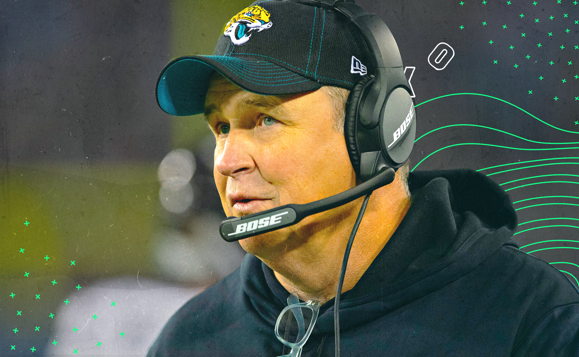 Jacksonville coach Doug Marrone looks into the distance, wearing a head set and a Jaguars hat