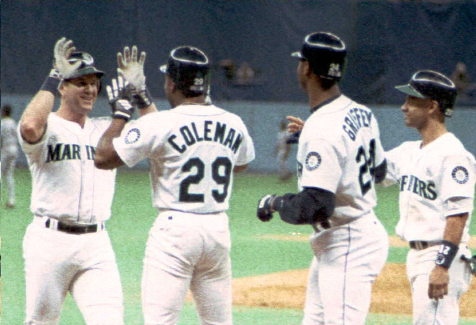 Edgar Martinez of the Seattle Mariners (L) is gree