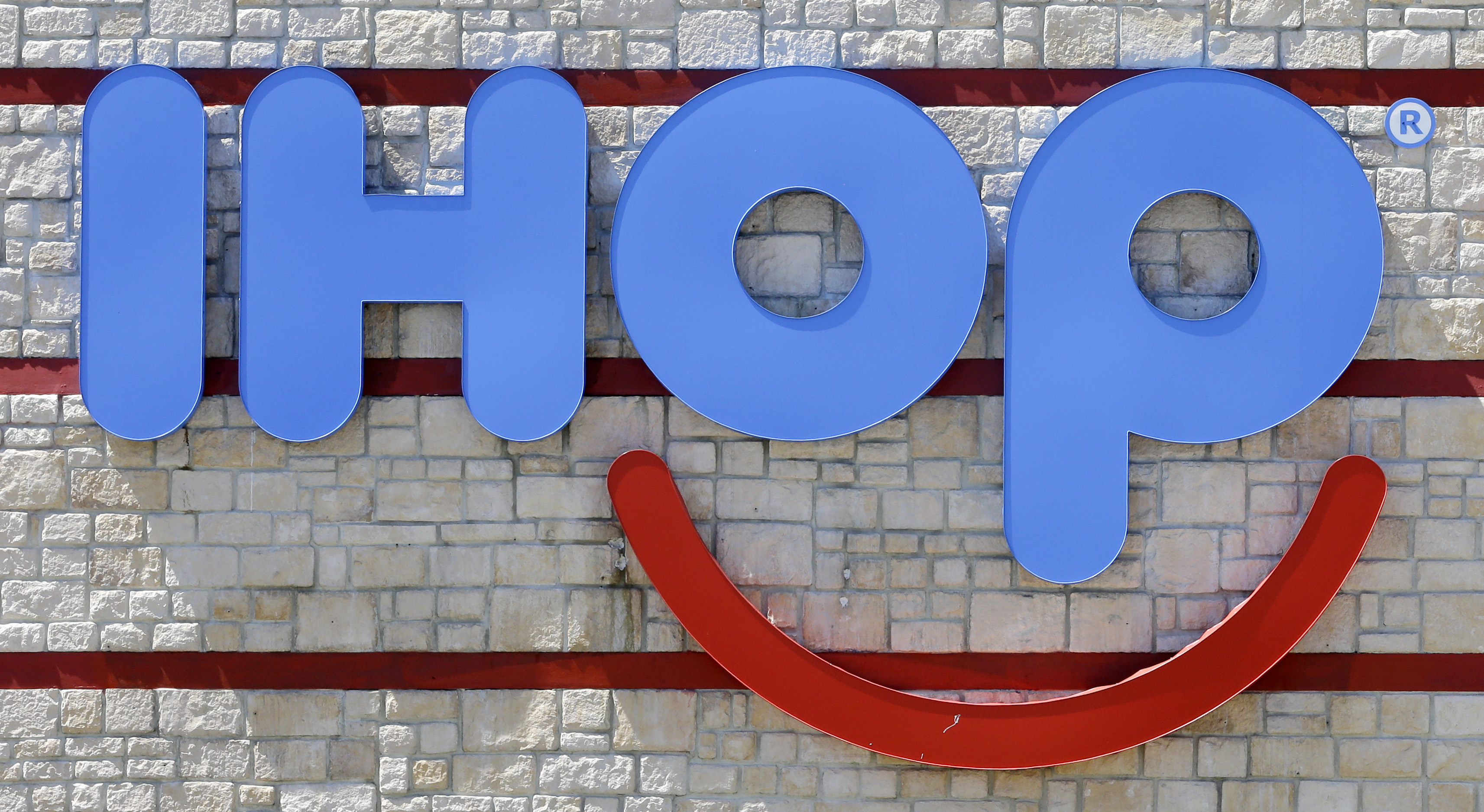 This photo taken Thursday, May 11, 2017, shows an IHOP sign at a restaurant in Hialeah, Fla.