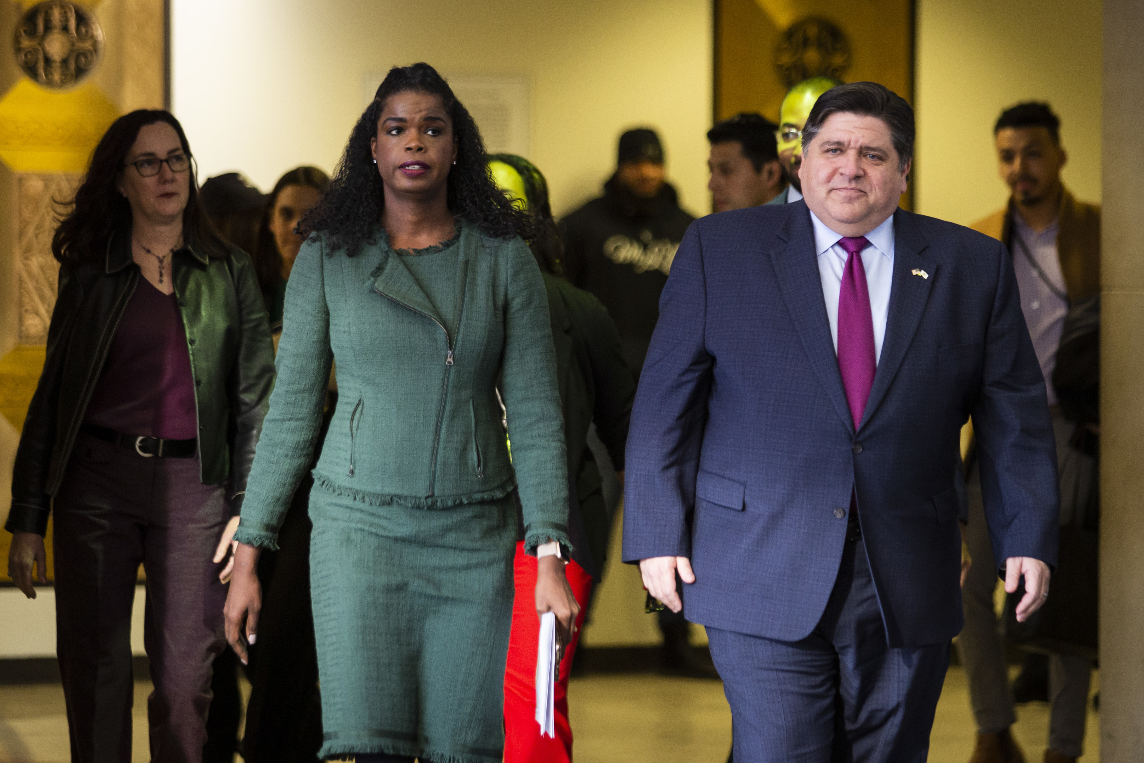 Cook County State's Attorney Kim Foxx and Gov. J.B. Pritzker walk toward a press conference at the Leighton Criminal Courthouse after Foxx filed motions to vacate more than 1,000 low-level cannabis convictions, Wednesday afternoon, Dec. 11, 2019.