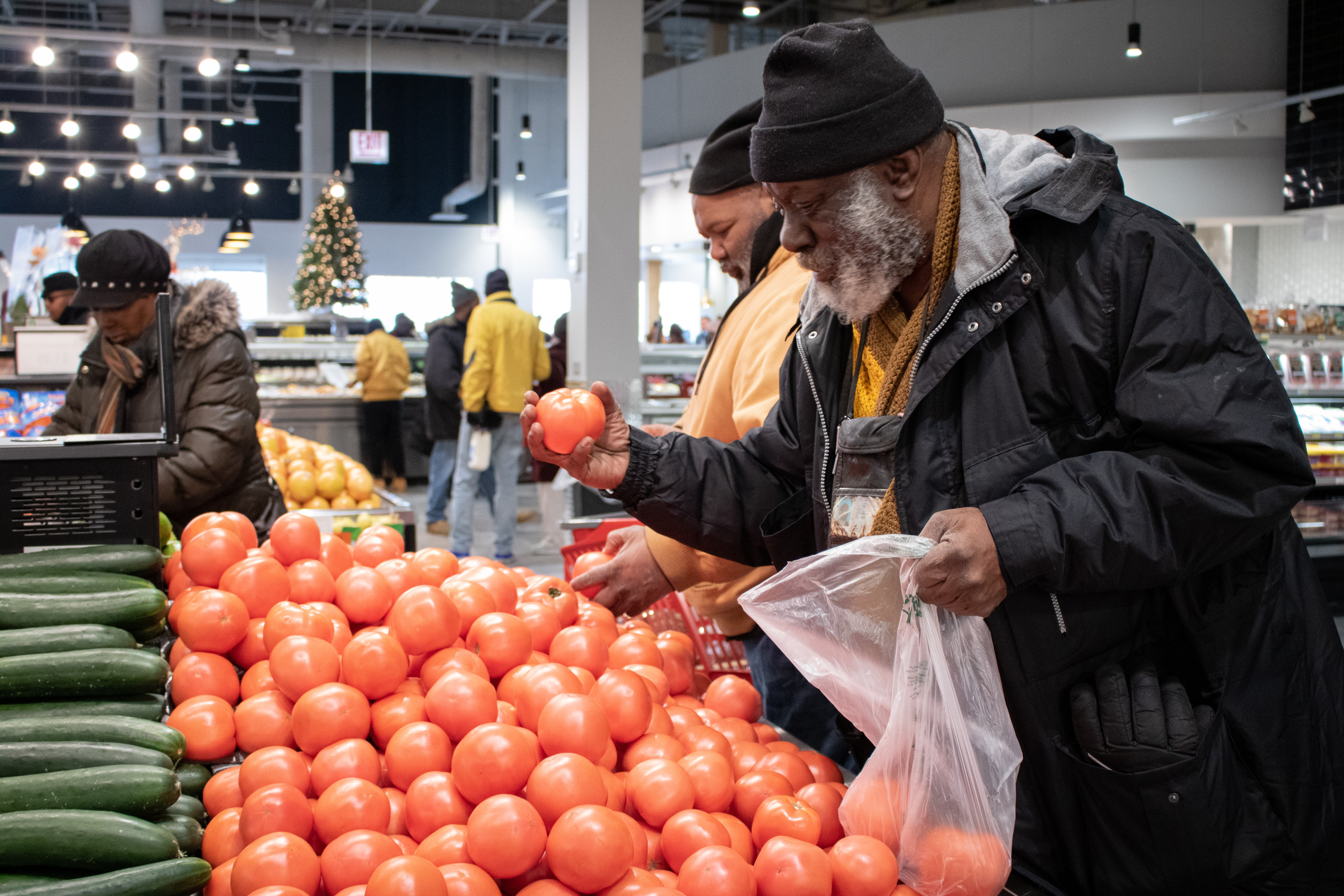 William Chatman shops for produce during the grand opening of Local Market in South Shore.