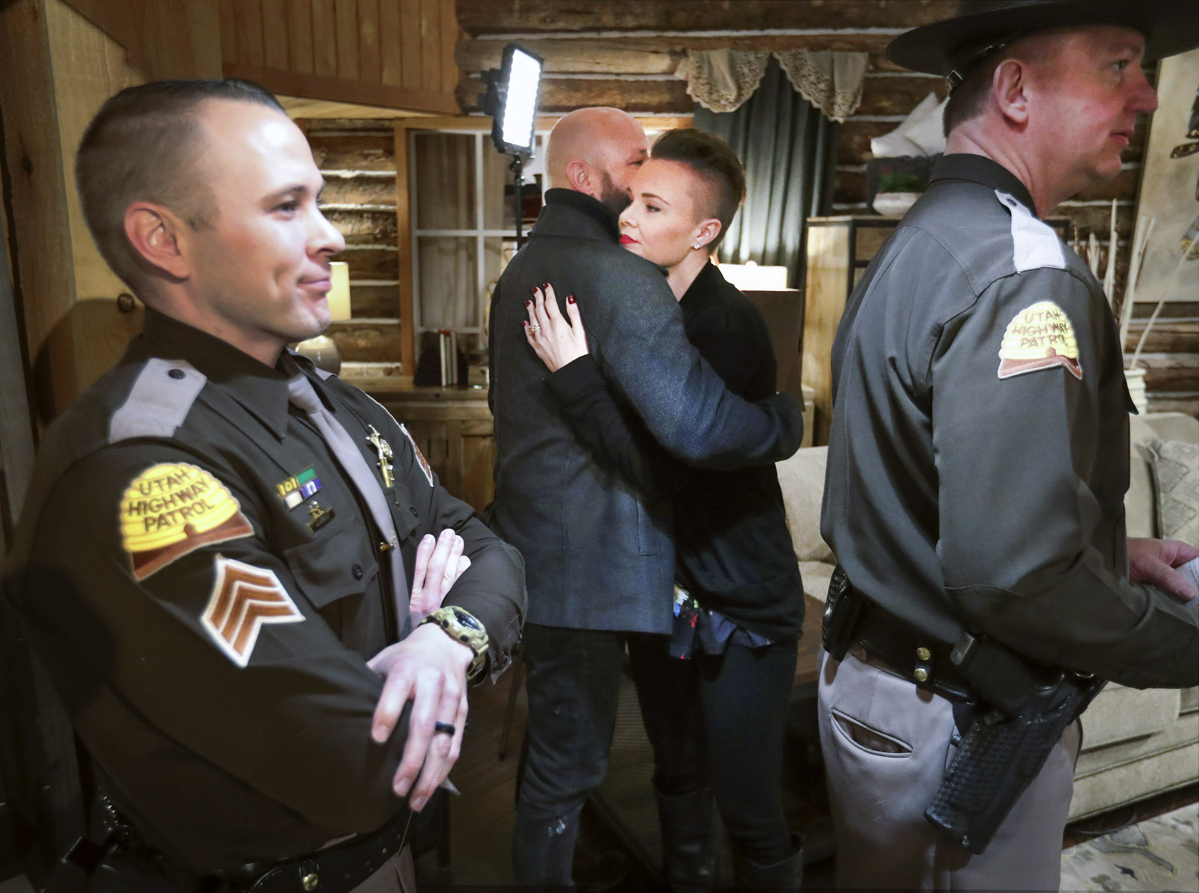 Hillary Staska, center right, hugs her husband, Justin Staska, as she stands with Utah Highway Patrol Sgt. Nick Bricker, left, and Utah Highway Patrol Lt. Col. Mark Zesiger, after she and Bricker talked about her arrest for DUI four years ago during a press conference at the RC Willey store in South Salt Lake on Wednesday, Dec. 11, 2019. Staska credits Bricker and the arrest with saving her life. The press conference kicked off the Utah Department of Public Safety's annual holiday DUI enforcement effort campaign.