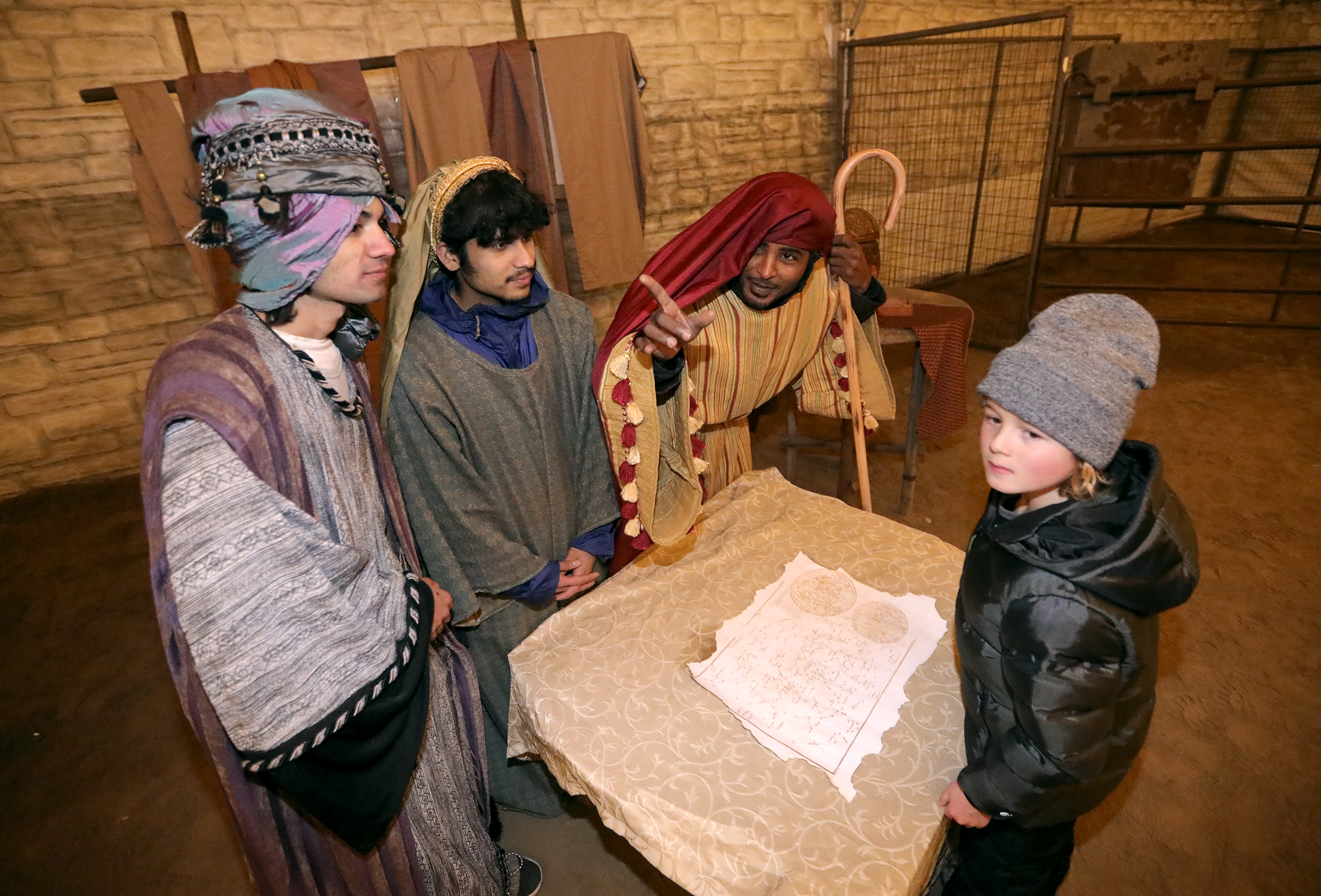 """Biidur Dhakal, Ashis Dhakal and Adam Adam play wise men and show Stryder Low where to follow the star to find baby Jesus at """"A Babe Is Born"""" live Nativity at the Lehi Round-Up Rodeo Grounds in Lehi on Monday, Dec. 2, 2019. The Dhakals are refugees from Nepal, and Adam is a refugee from Eritrea."""