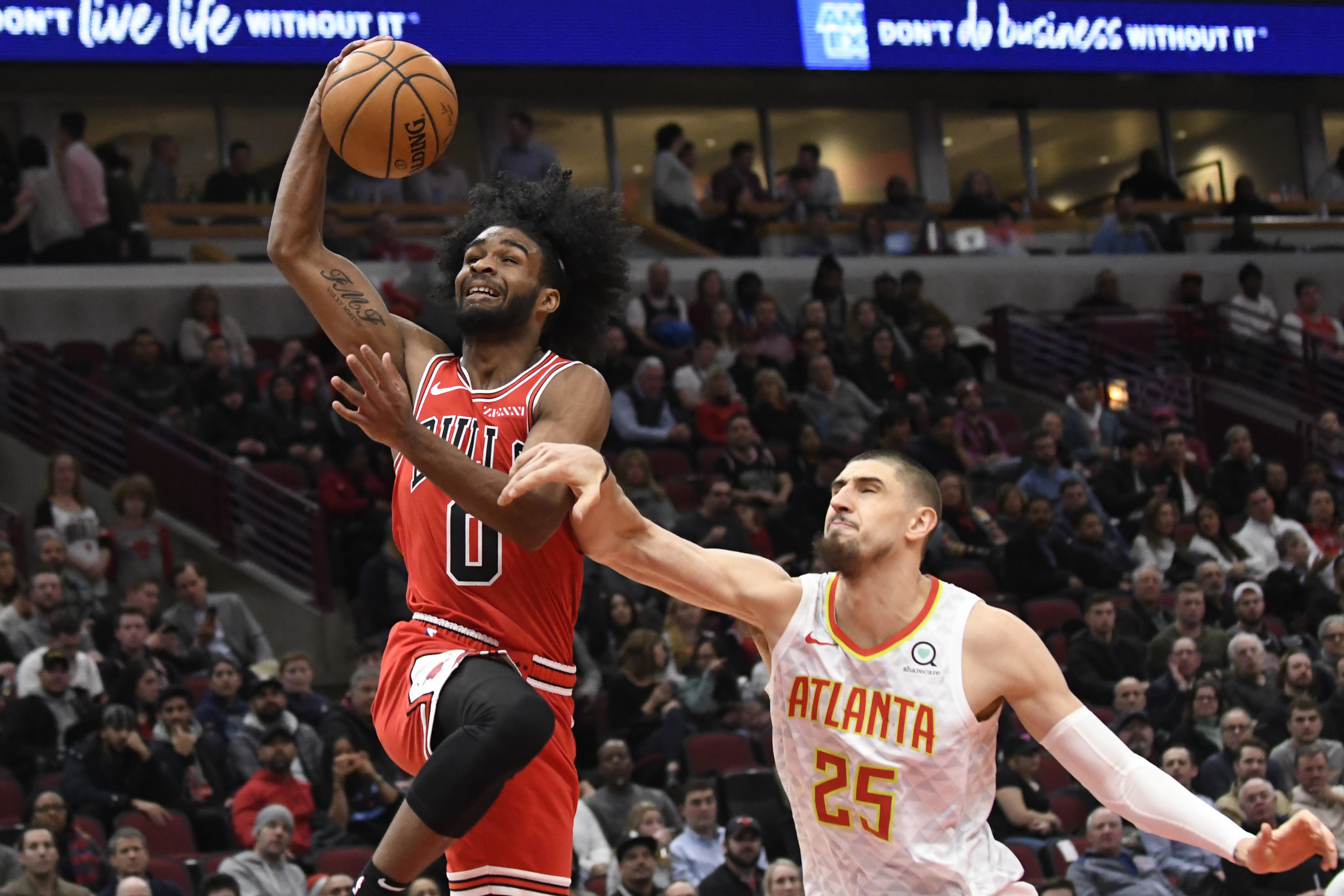 Bulls guard Coby White goes to the basket past Hawks center Alex Len Wednesday at the United Center.