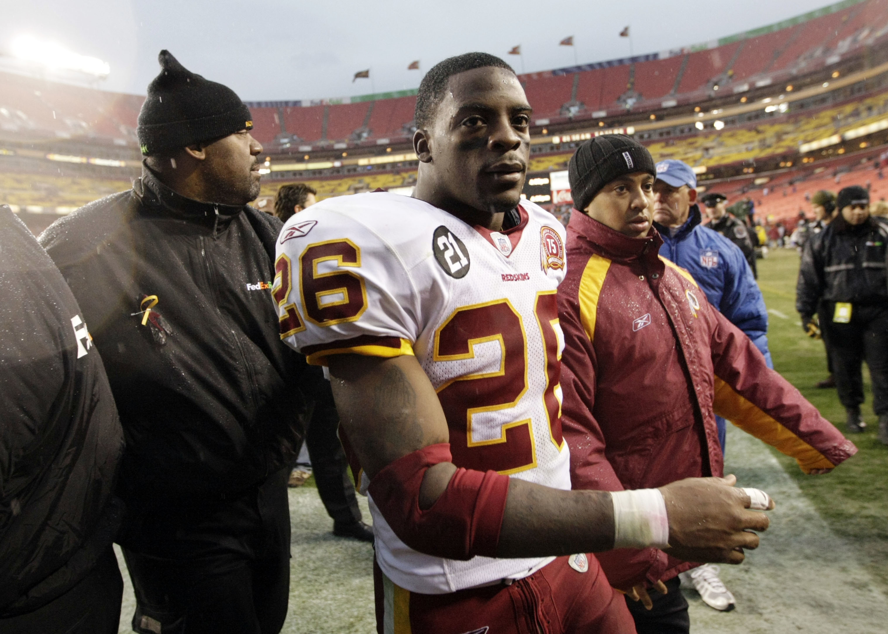 Clinton Portis, shown after a 2007 game, is one of 10 former NFL players charged with defrauding a healthcare program.
