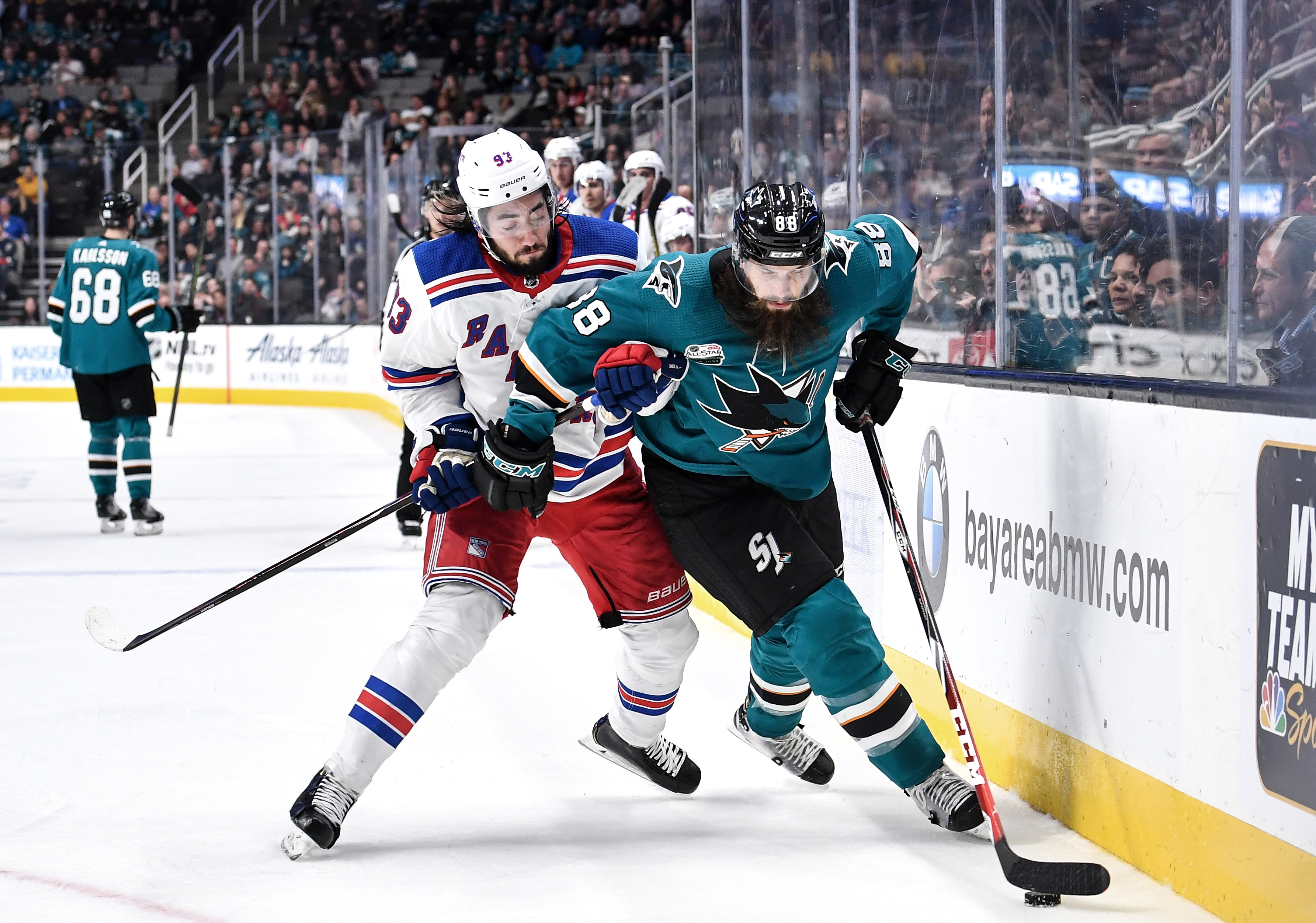 SAN JOSE, CA - OCTOBER 30: (R-L) Brent Burns #88 of the San Jose Sharks fights for the puck against Mika Zibanejad #93 the New York Rangers at SAP Center on October 30, 2018 in San Jose, California