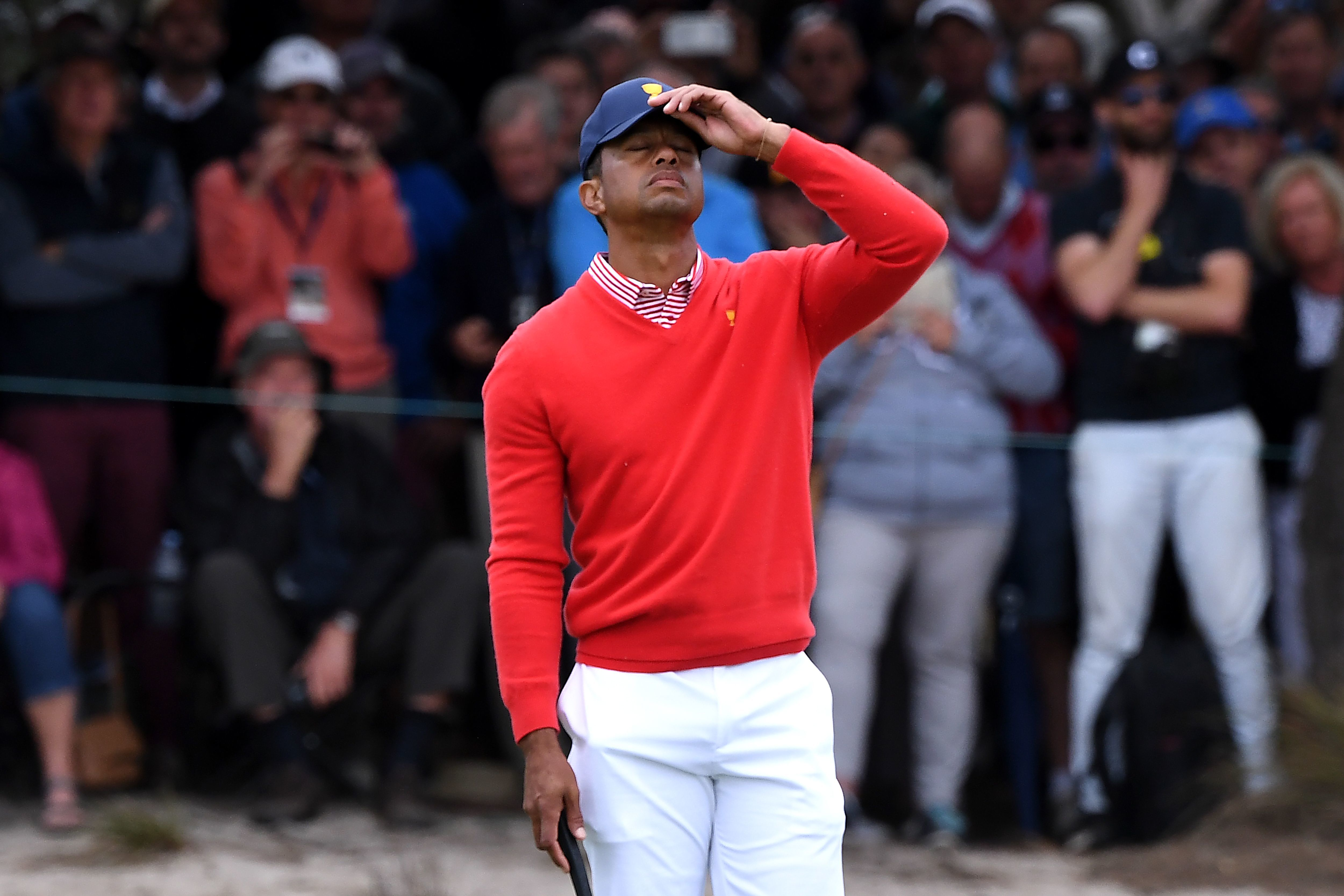 U.S. team captain Tiger Woods reacts during Day 1 of the Presidents Cup golf tournament in Melbourne, Australia.