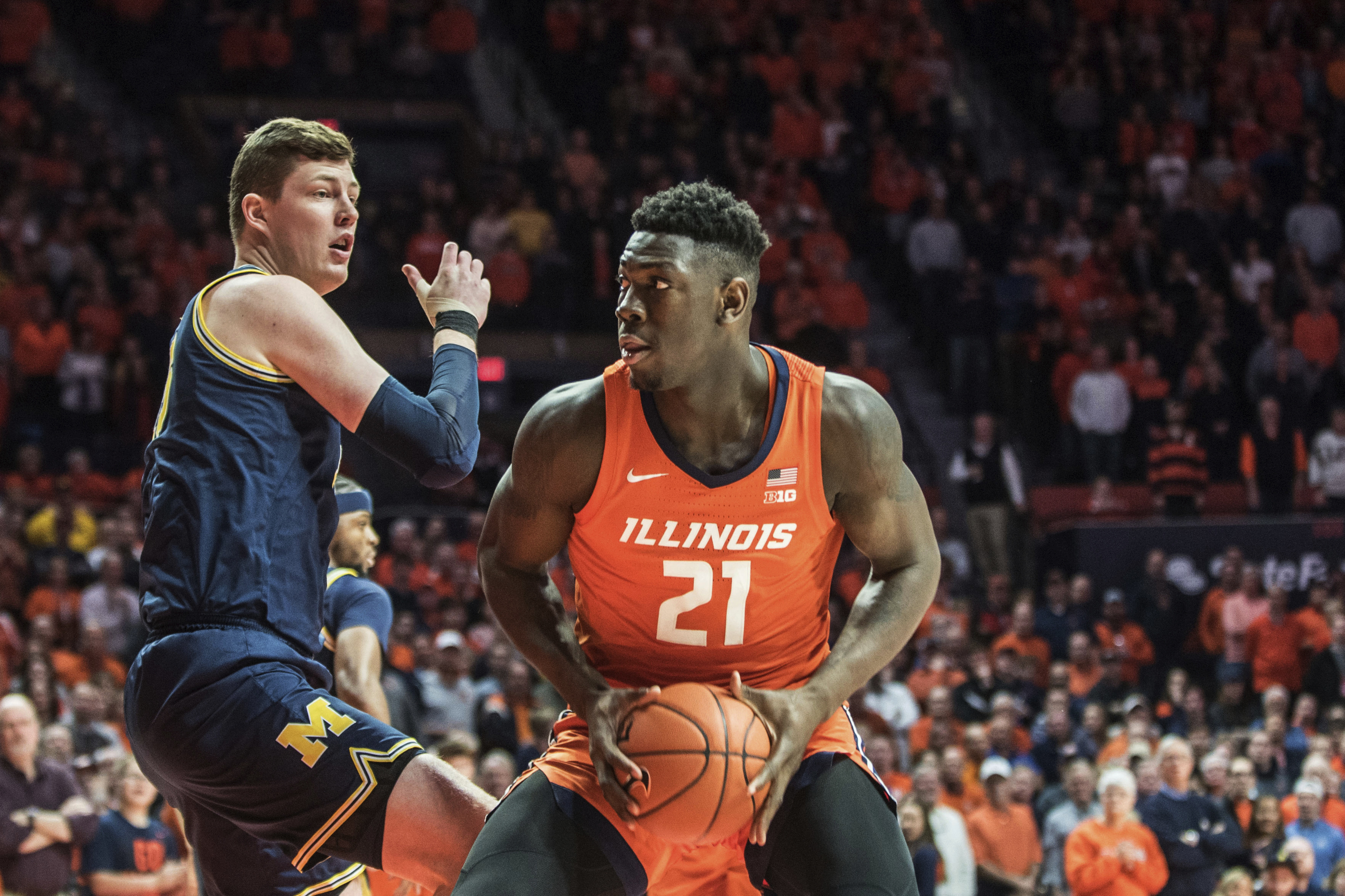 Illinois' Kofi Cockburn looks to shoot as Michigan's Jon Teske defends during the Illini's win over the Wolverines Wednesday in Champaign.
