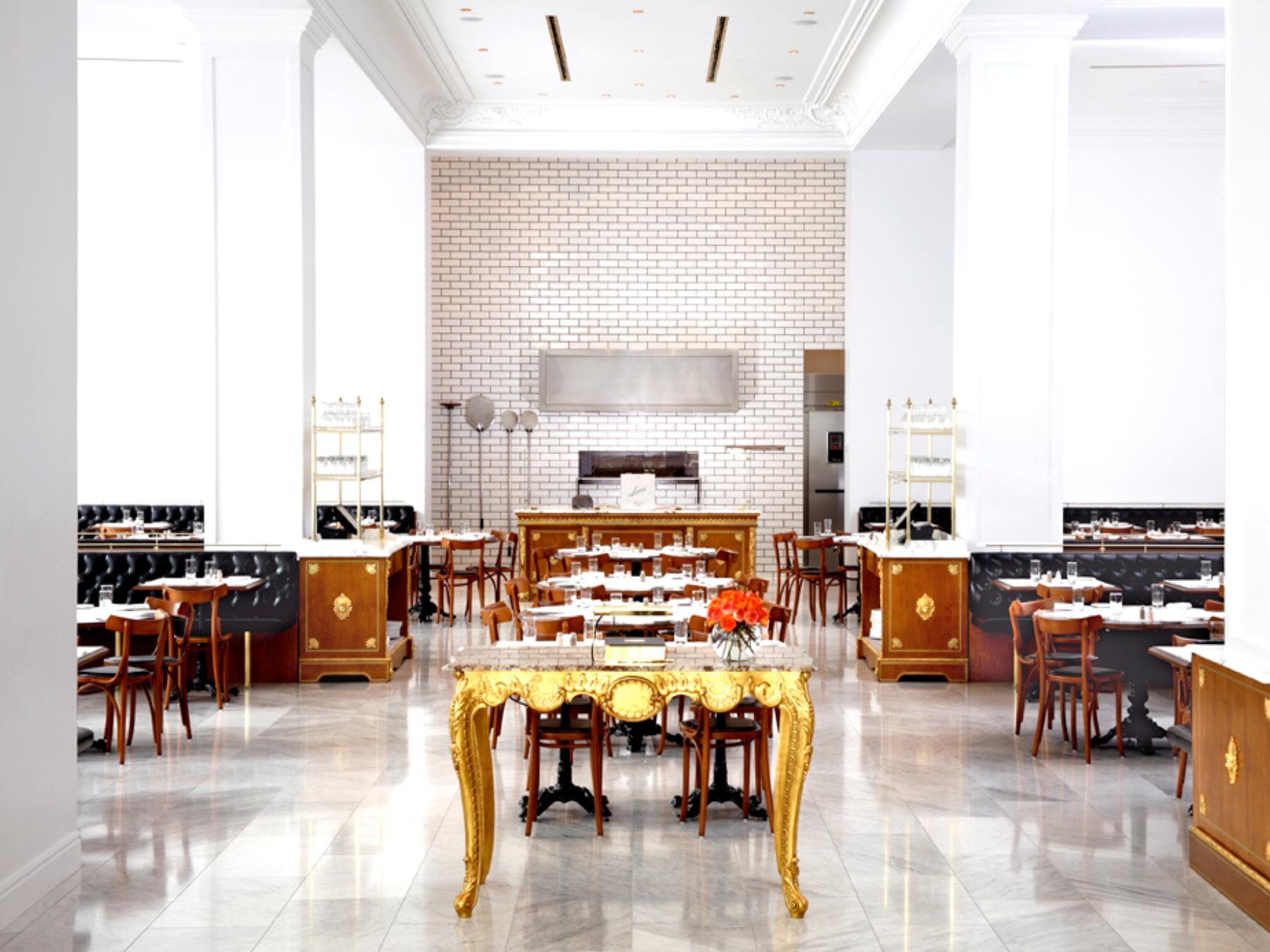 Bottega Louie's marble and gold restaurant interior.