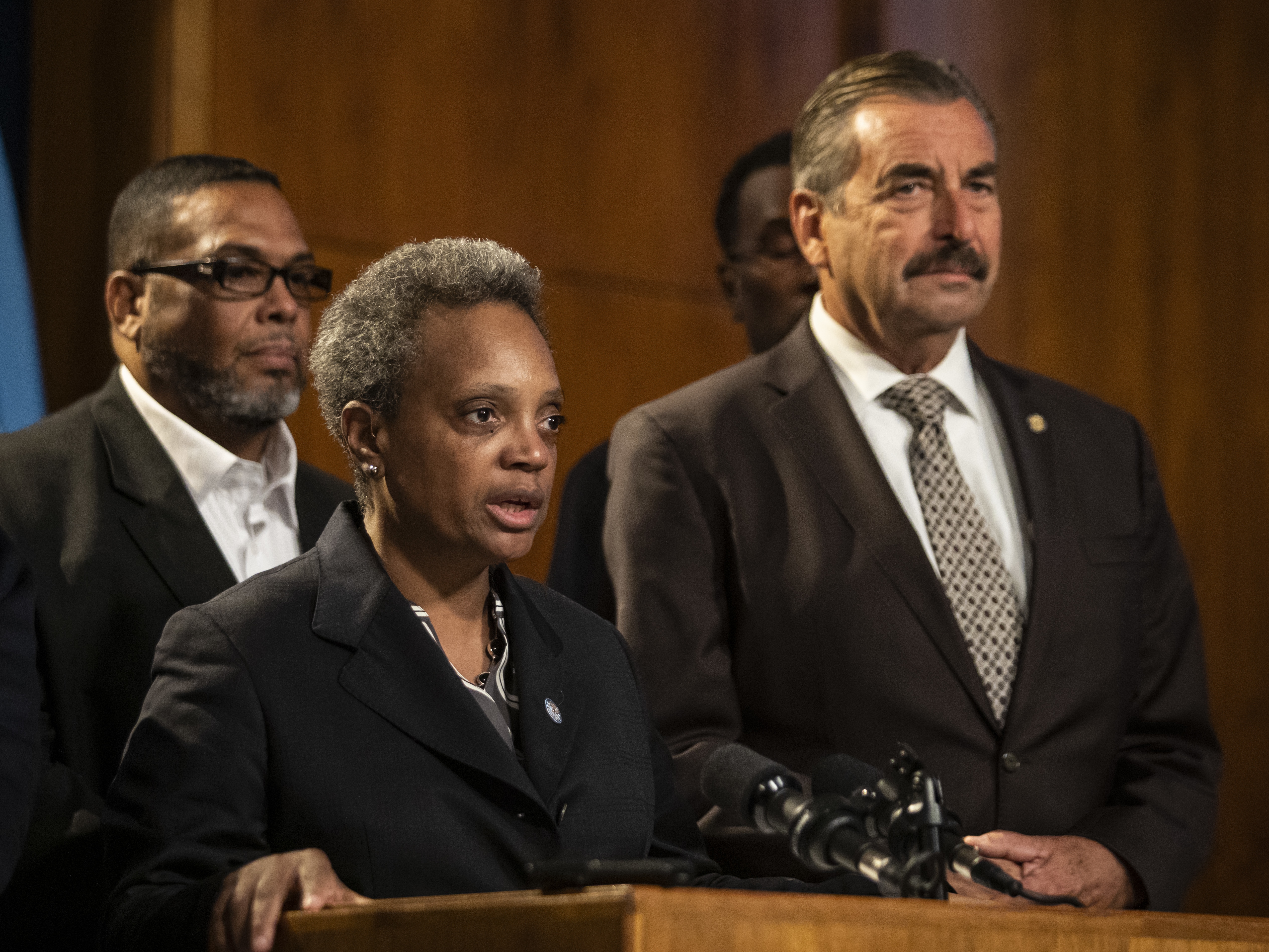Mayor Lori Lightfoot speaks during a press conference at City Hall, announcing former Los Angeles Police Chief Charlie Beck (right) would serve as Chicago's interim police superintendent, Friday morning, Nov. 8, 2019.