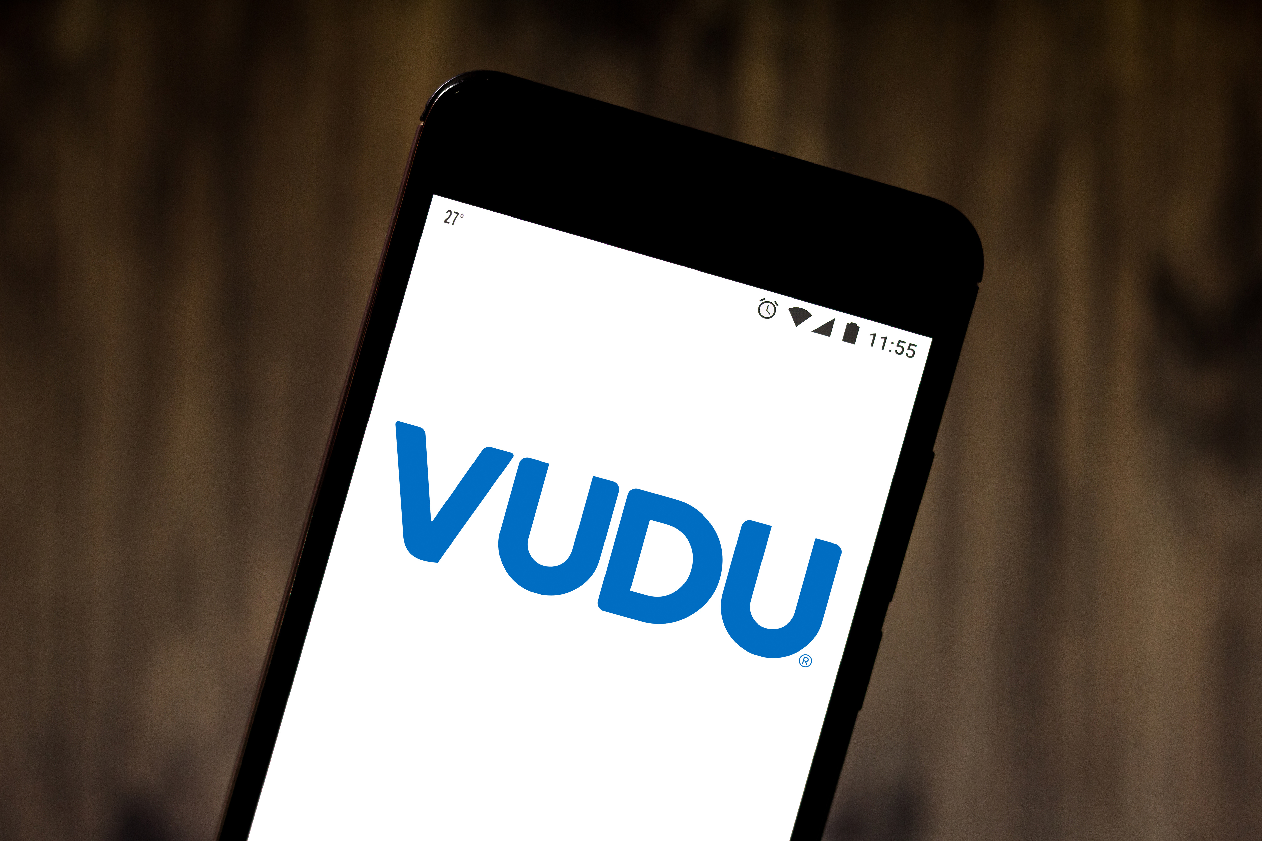 In this photo illustration the Vudu logo is seen displayed...